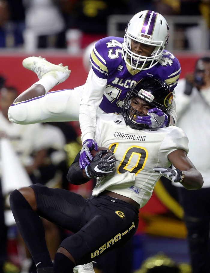 Alcorn State's Javen Morrison (45) tries to intercept a pass to Grambling State's Chad Williams (10) during the third quarter of the Southwestern Athletic Conference NCAA college football championship game Saturday, Dec. 3, 2016, in Houston.