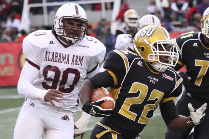 Alabama A&M defensive lineman Anthony Lanier (90), left, chase down Alabama State running back Malcolm Cyrus (22) in the game between Alabama State and Alabama A&M.