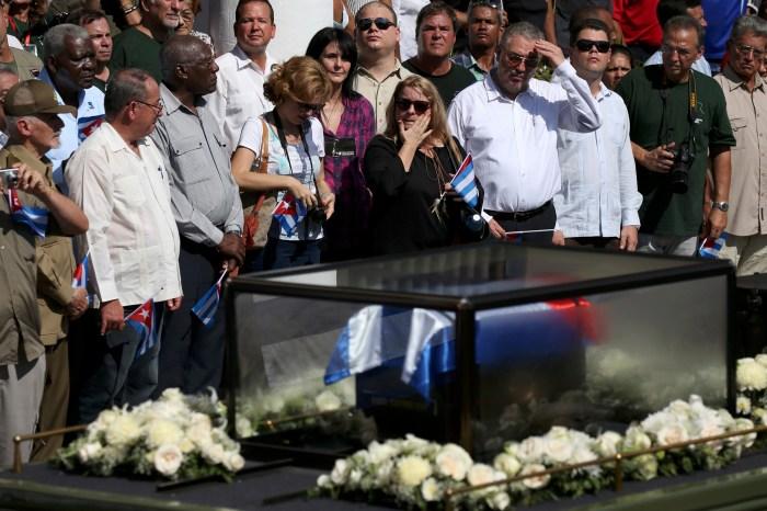 People line a street to watch as the caravan carrying the ashes of Cuba's late President Fidel Castro arrives in Santiago de Cuba, Cuba, December 3, 2016.