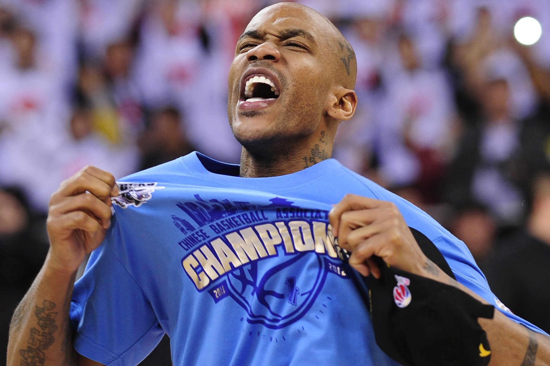 Marbury celebrates after his team, the Beijing Ducks, won their first-ever Chinese championship. Marbury scored 41 points as the host team knocked off title holders Guangdong Tigers 124-121.
