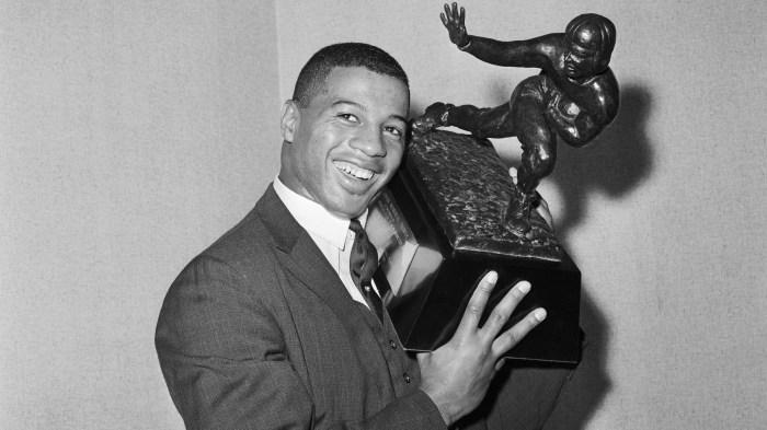 Ernie Davis Holding Trophy