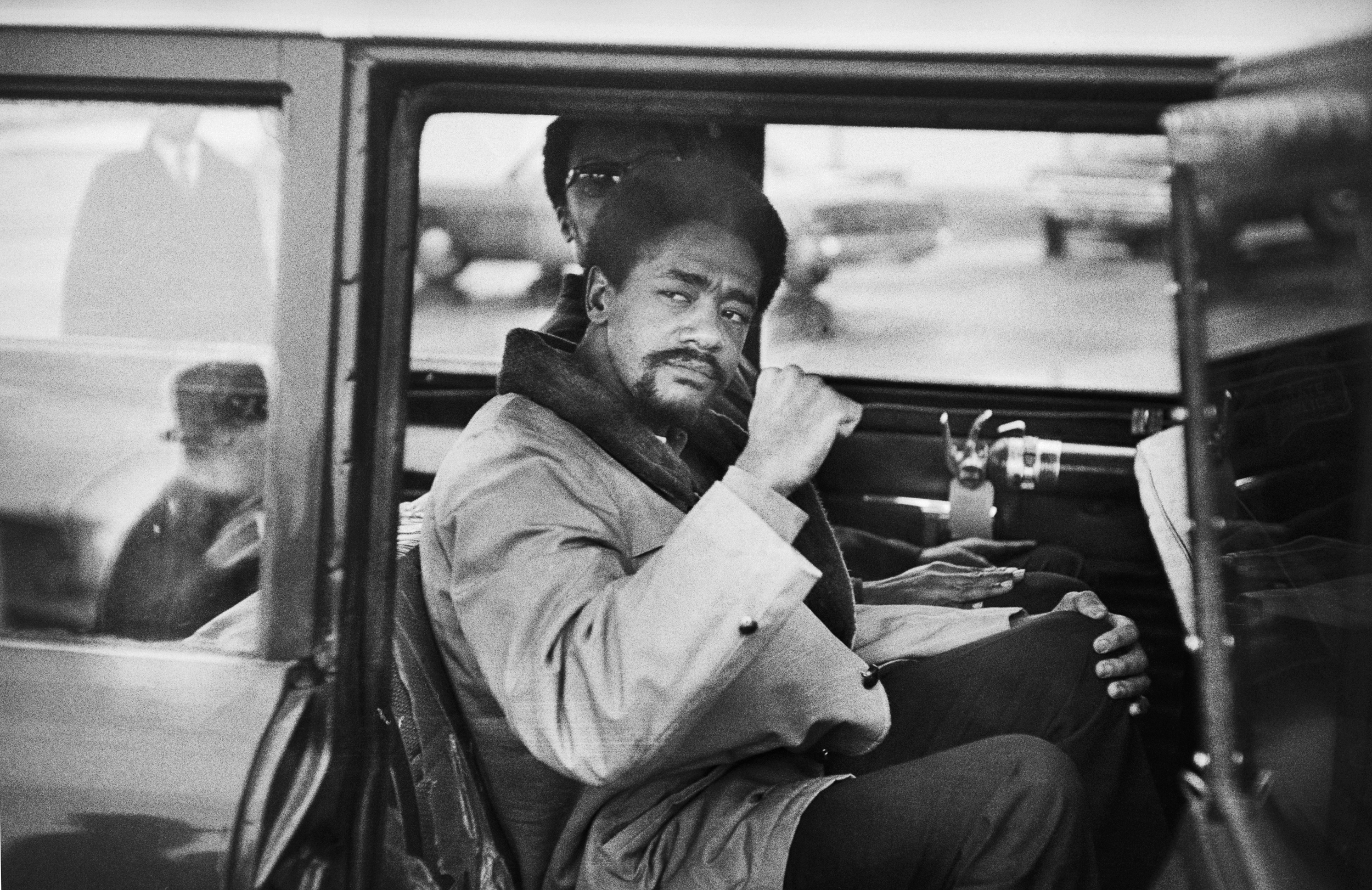 Black Panther leader Bobby Seale gives a black power salute as he leaves Hartford's Bradley Airport for the trip to New Haven. Seale faces trial in connection with the murder of Alex Rackley.