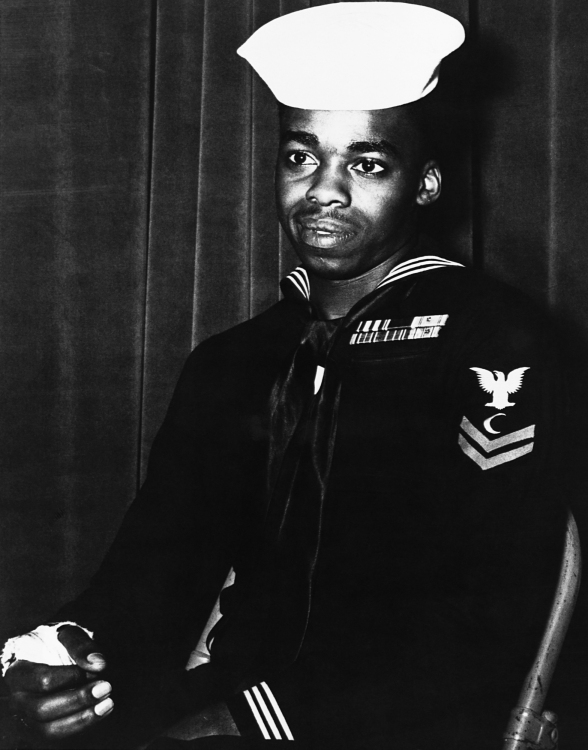 Ship's cook third class Dorie Miller was decorated for firing at Japanese aircraft on his own initiative during the attack on Pearl Harbor.