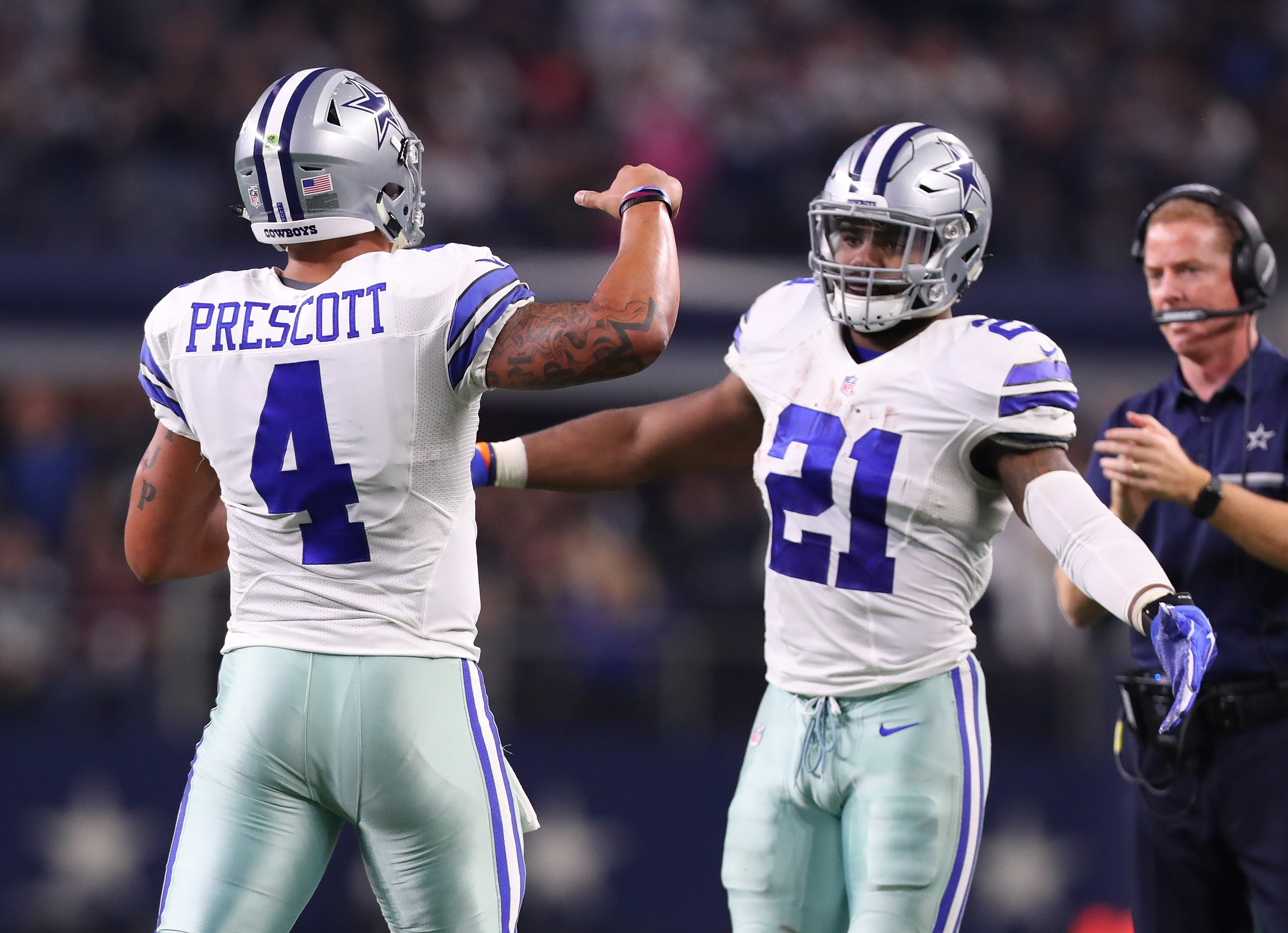 ARLINGTON, TX - DECEMBER 18: Dak Prescott #4 and Ezekiel Elliott of the Dallas Cowboys celebrate after scoring a touchdown during the second quarter against the Tampa Bay Buccaneers at AT&T Stadium on December 18, 2016 in Arlington, Texas.