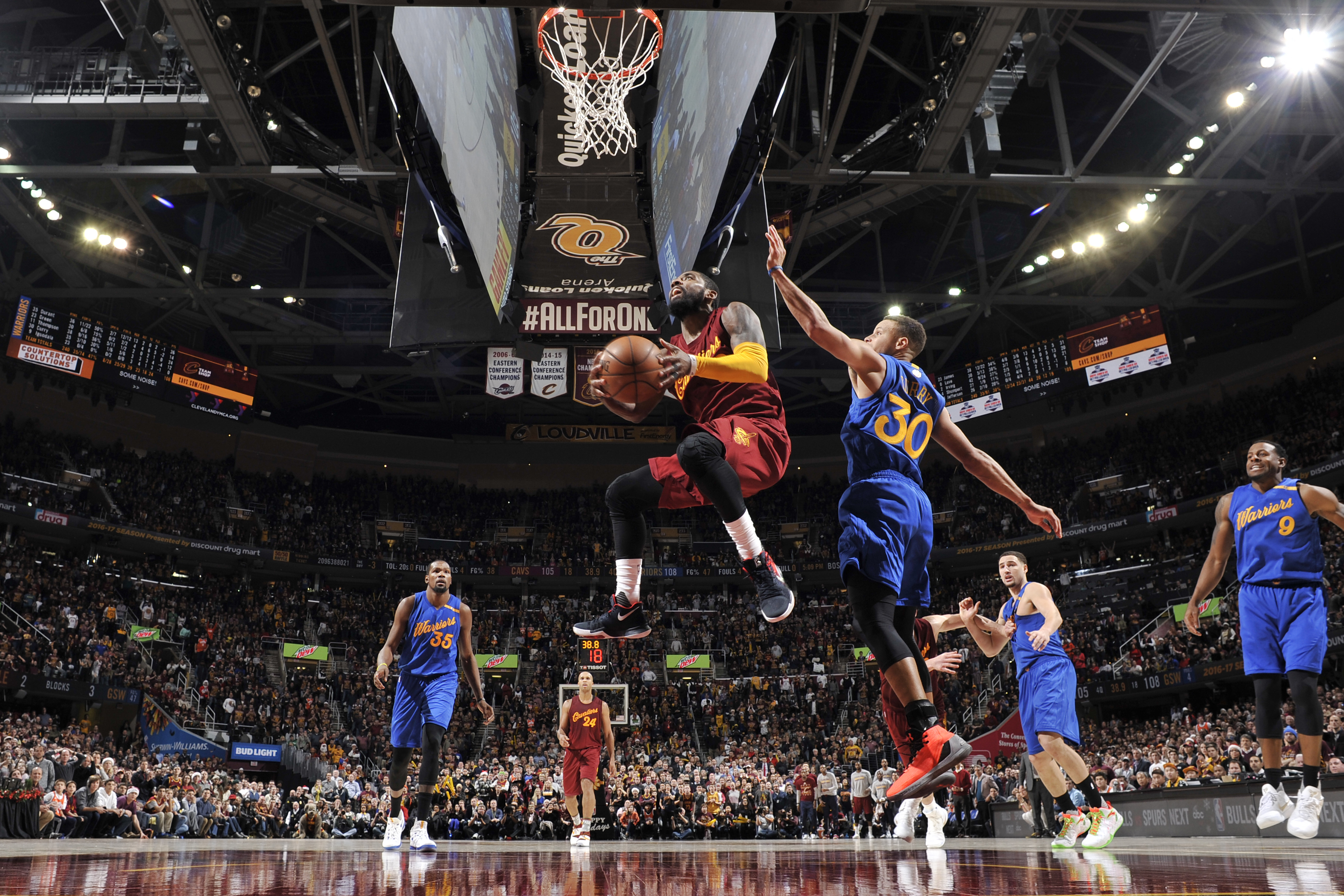 Kyrie Irving #2 of the Cleveland Cavaliers drives to the basket against the Golden State Warriors on December 25, 2016 at Quicken Loans Arena in Cleveland, Ohio.