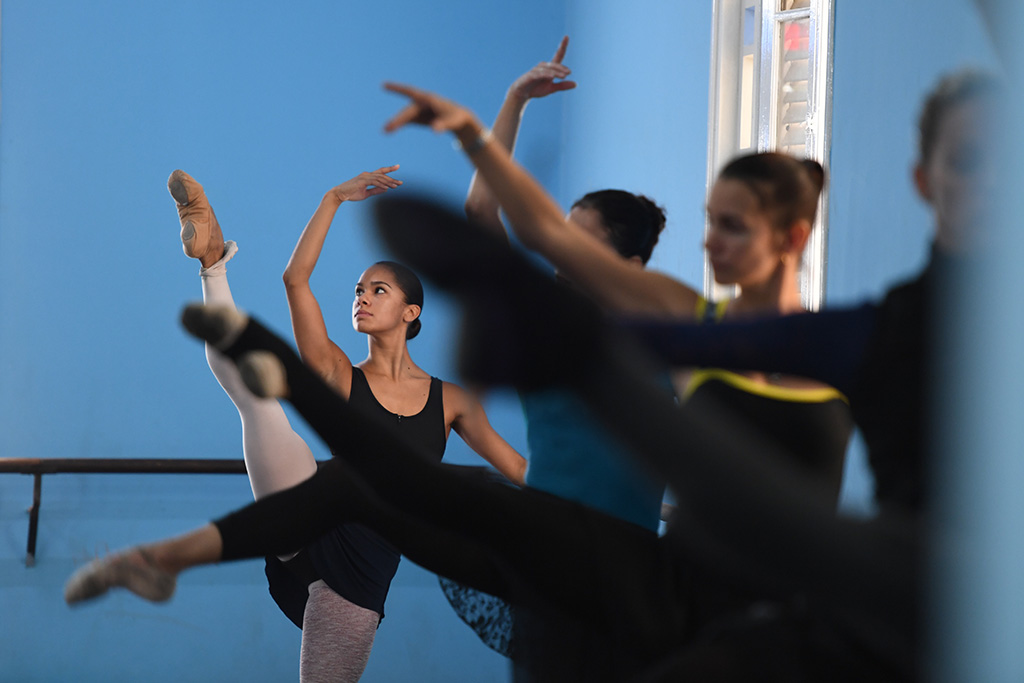Misty Copeland goes through leg stretches while preparing to take part in her first class with the Cuban National Ballet on Nov. 15, 2016, in Havana, Cuba.