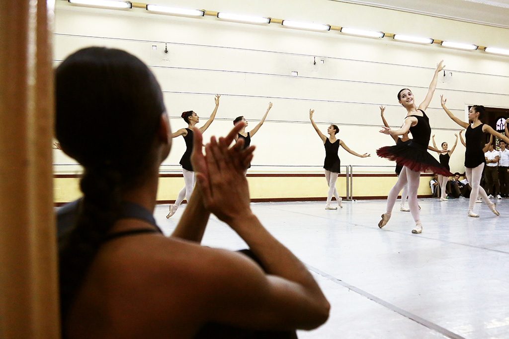 Misty Copeland applauds a performance from the students at the National Ballet School, after leading them through a class Nov. 15, 2016, in Havana, Cuba.