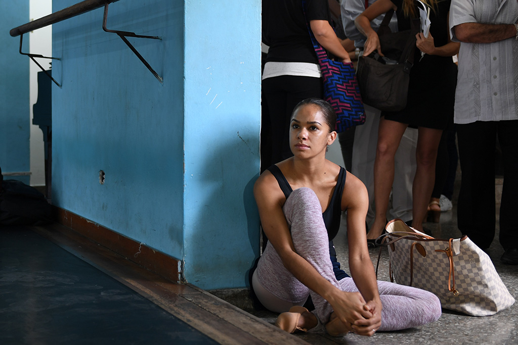 Misty Copeland watches as members of the Cuban National Ballet warm up Nov. 15, 2016, in Havana, Cuba.