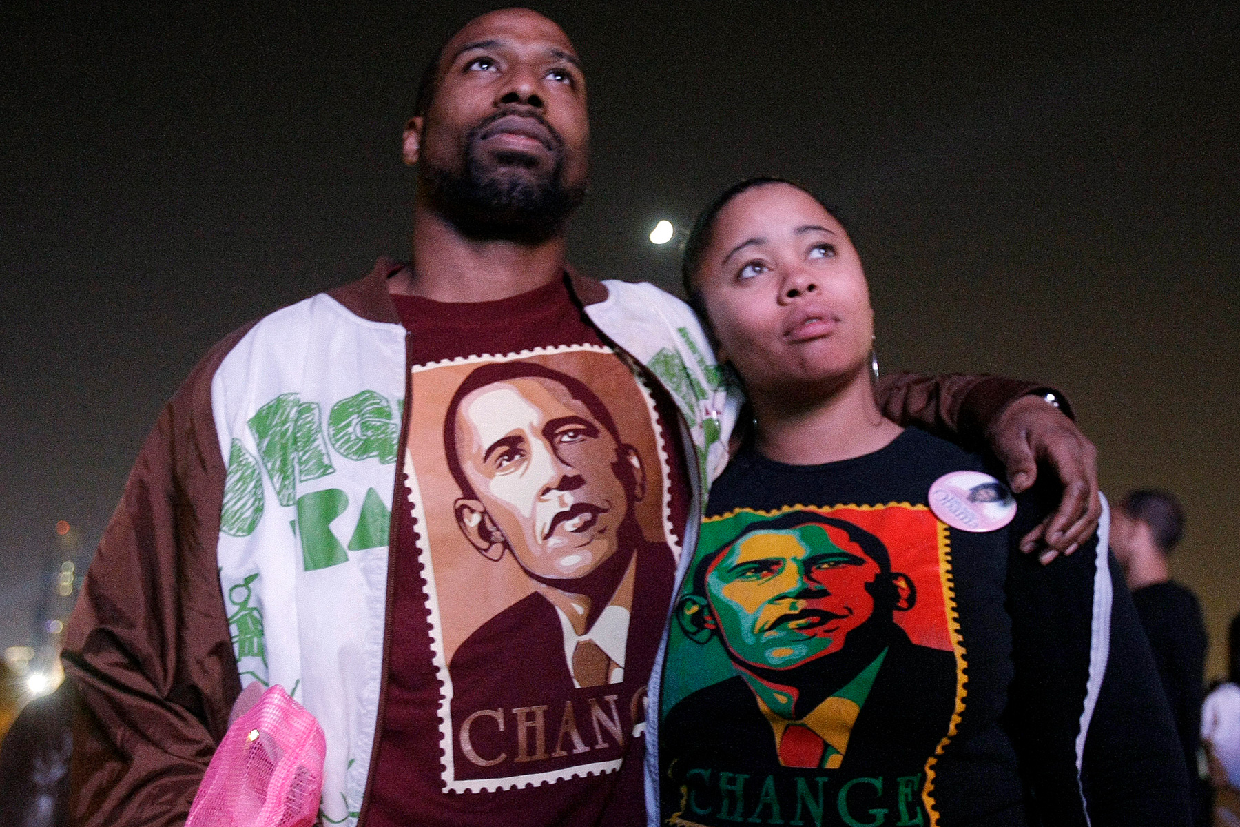 Gregory McGee, left, and Jakeeta Stubblefield from Chicago, supporters of Democratic presidential candidate Sen. Barack Obama, D-Ill, watch election returns on a big screen TV in an overflow area of Grant Park Nov. 4, 2008.