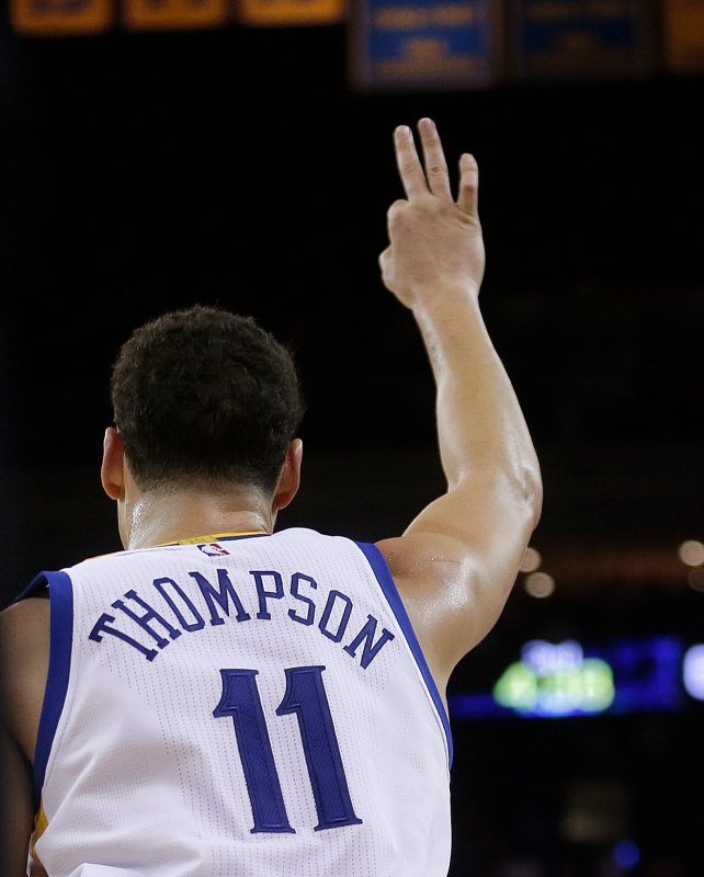 Golden State Warriors' Klay Thompson celebrates a score during the third quarter of an NBA basketball game against the Indiana Pacers Monday, Dec. 5, 2016, in Oakland, Calif.