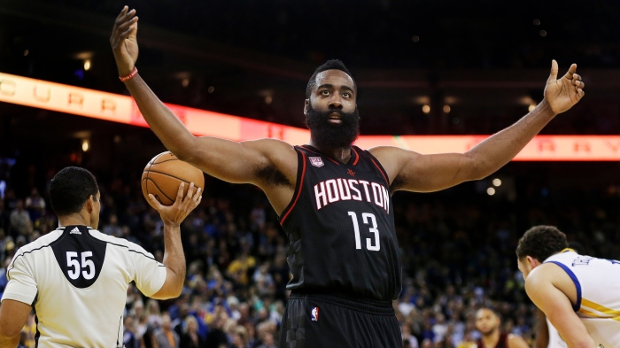 2d14cb037cc Houston Rockets  James Harden (13) gestures to fans during the second half  of an NBA basketball game against the Golden State Warriors Thursday