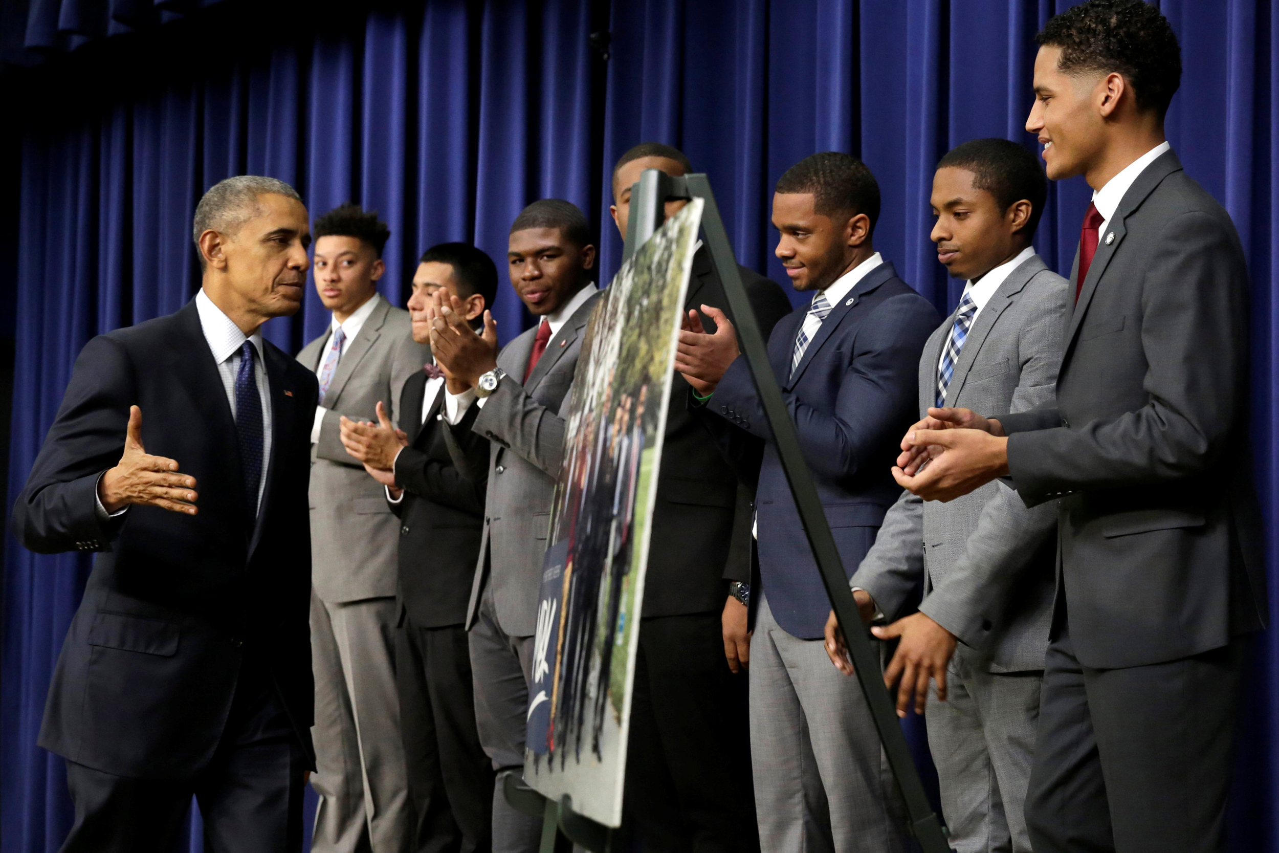 U.S. President Barack Obama (L) greets attendees at the My Brother's Keeper Summit at the South Court Auditorium of the White House in Washington, U.S., December 14, 2016.