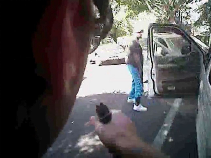 Keith Scott looks over to police with hands by his sides just before he was shot four times by Charlotte police in Charlotte, North Carolina, U.S. in this September 20, 2016 still image from video released by Charlotte police.