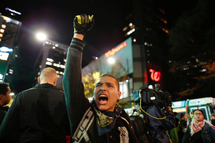 Protesters march through uptown Charlotte, North Carolina November 30, 2016, following the decision of the district attorney not to press criminal charges against police in the shooting of Keith Scott.