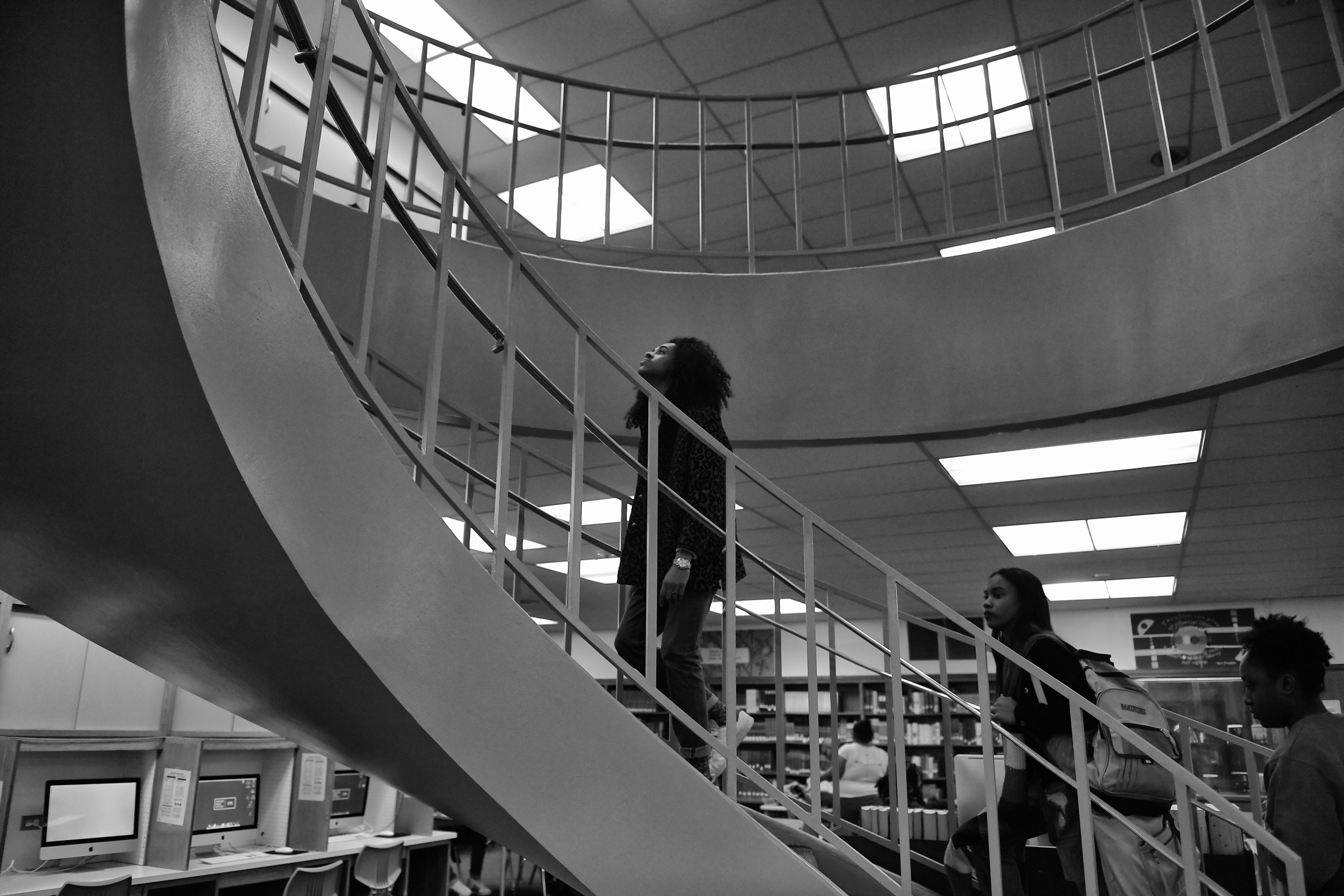 leads his fellow students up the stairs in the library on January 10, 2017 at Kenwood High School in Chicago, Illinois.