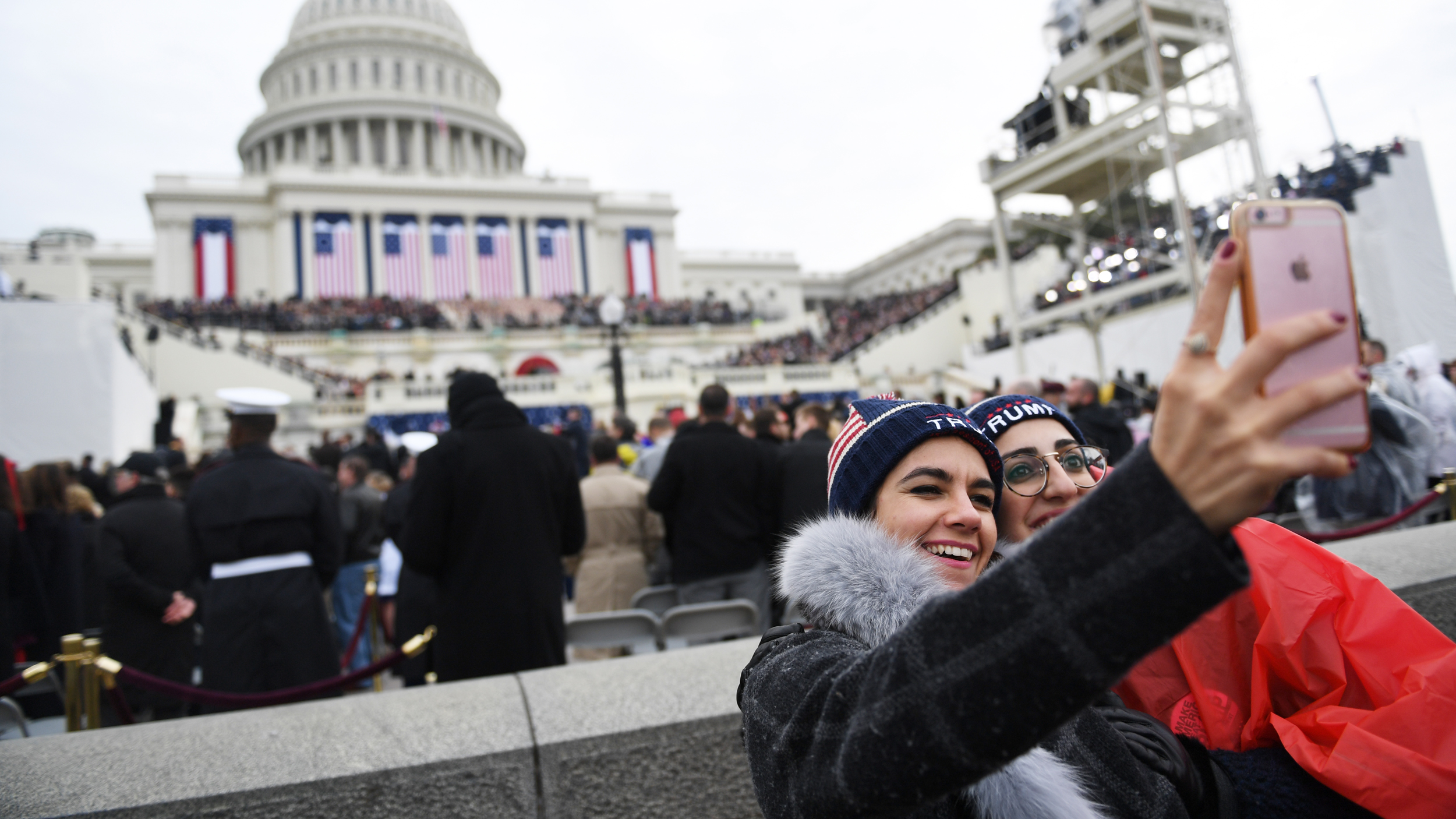 Supporters of Donald Trump take selfies before the start of during the inauguration of President Donald Trump January 20, 2017 on the National Mall in Washington D.C.