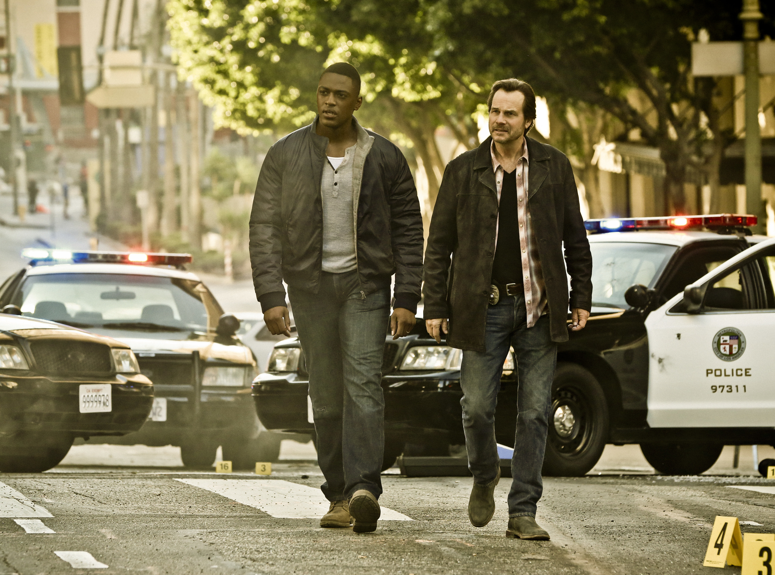 Training Day is a crime drama that begins 15 years after the events of the feature film, starring Bill Paxton as Frank Rourke (right), a hardened, morally ambiguous detective for the LAPD, and Justin Cornwell as Kyle Craig (left), a young, idealistic officer tapped to go undercover as his trainee and spy on him.