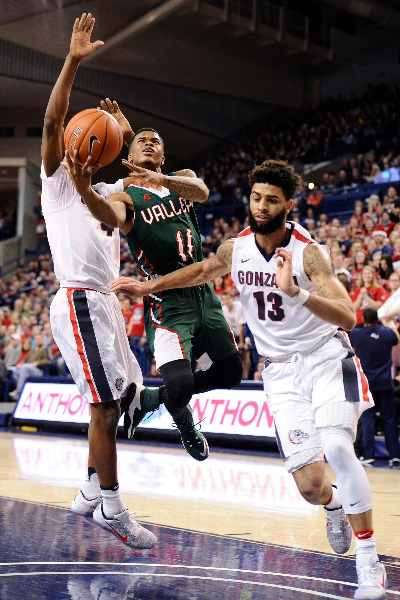 Mississippi Valley State Delta Devils guard Kylan Phillips (11) goes up for a basket against Gonzaga Bulldogs guard Josh Perkins (13) during the first half at McCarthey Athletic Center.