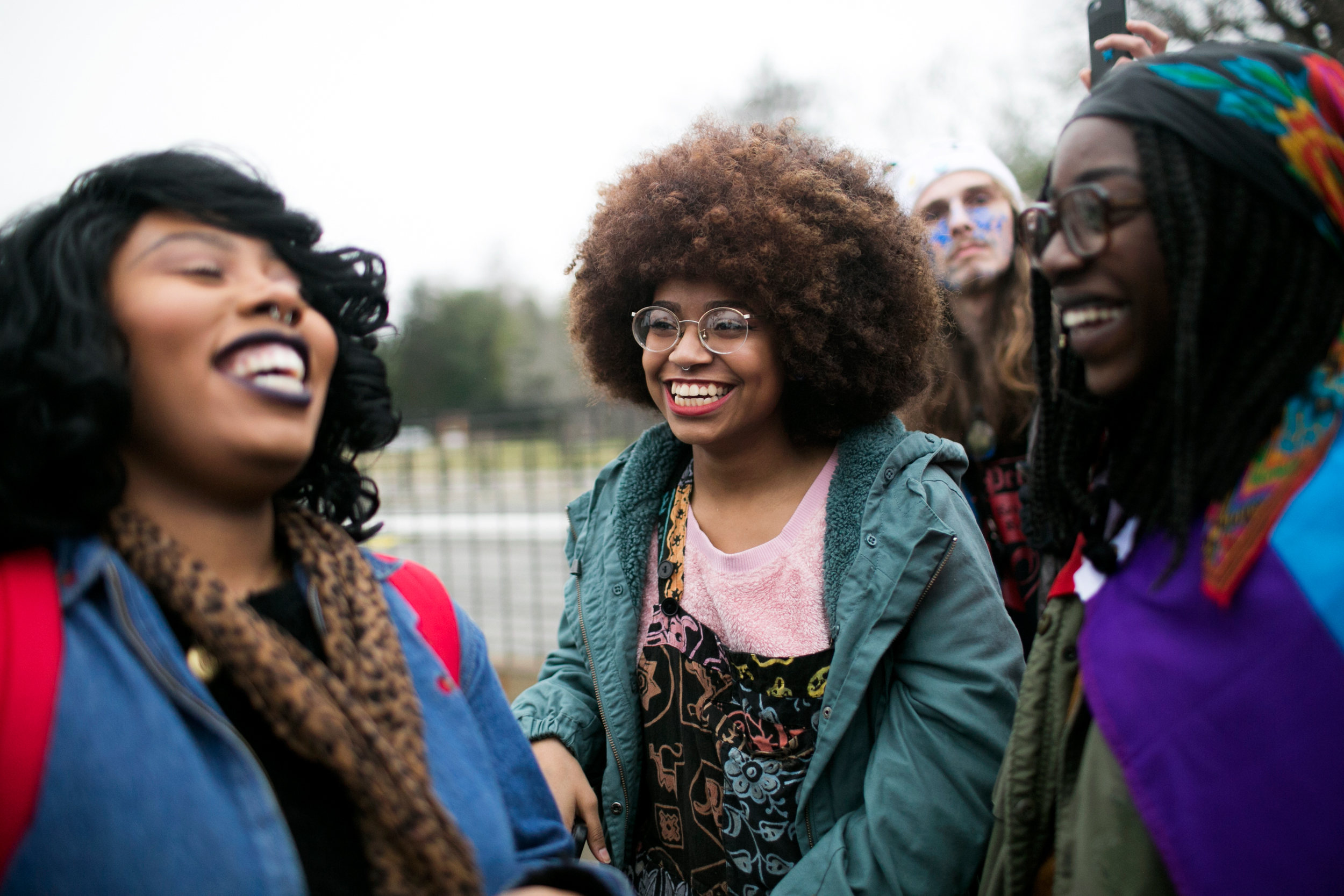 Quahmayla Brooks, Giovanna Dorvelus, and Beryl Kesslo participate in the Women's March in Washington, D.C. the day after Donald Trump's Inauguration.