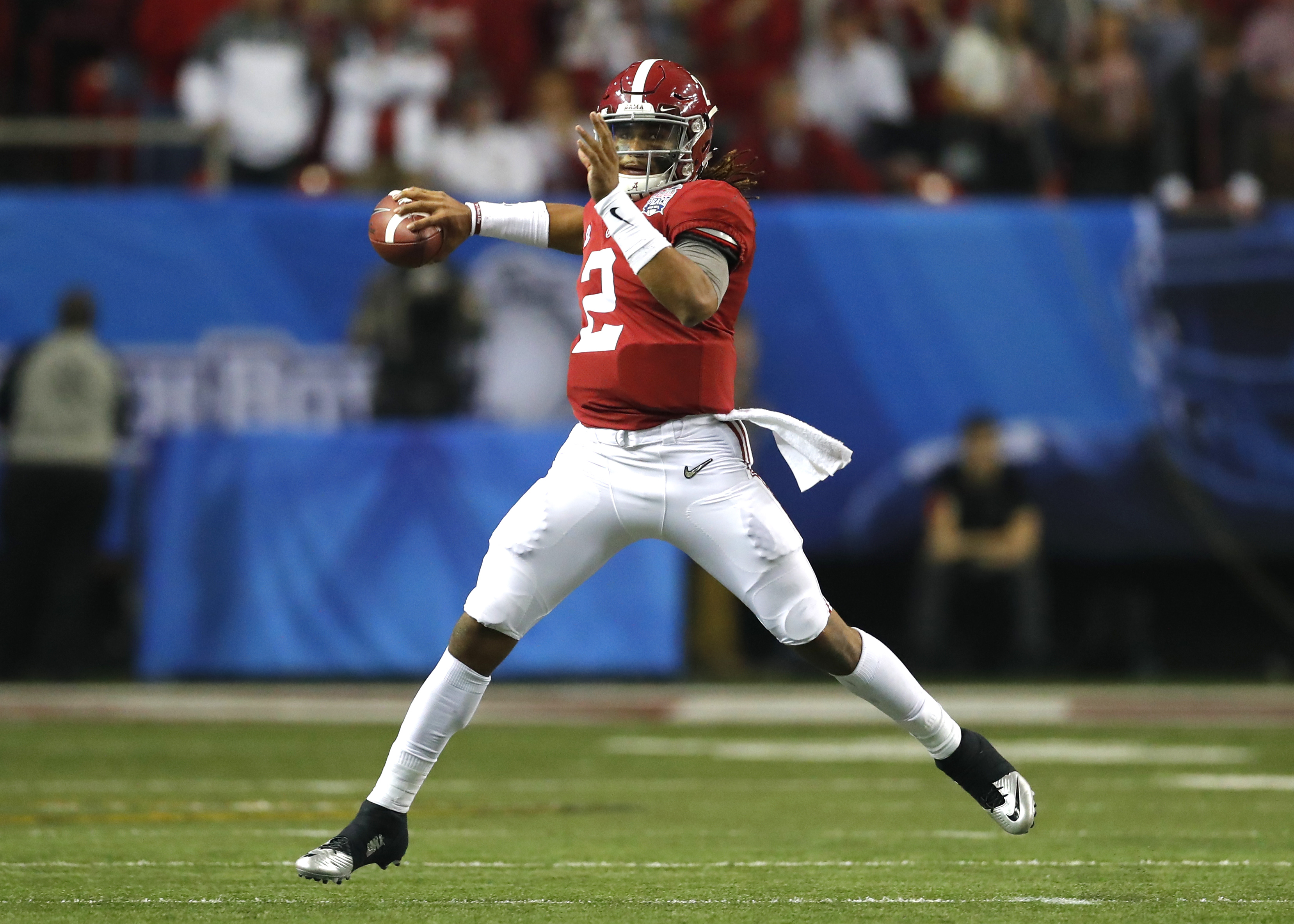 Alabama Crimson Tide quarterback Jalen Hurts (2) rolls out to pass during first half action of the Chick-Fil-A Peach Bowl football game between the Alabama Crimson Tide and Washington Huskies on December 31, 2016, at Georgia Dome in Atlanta, GA.