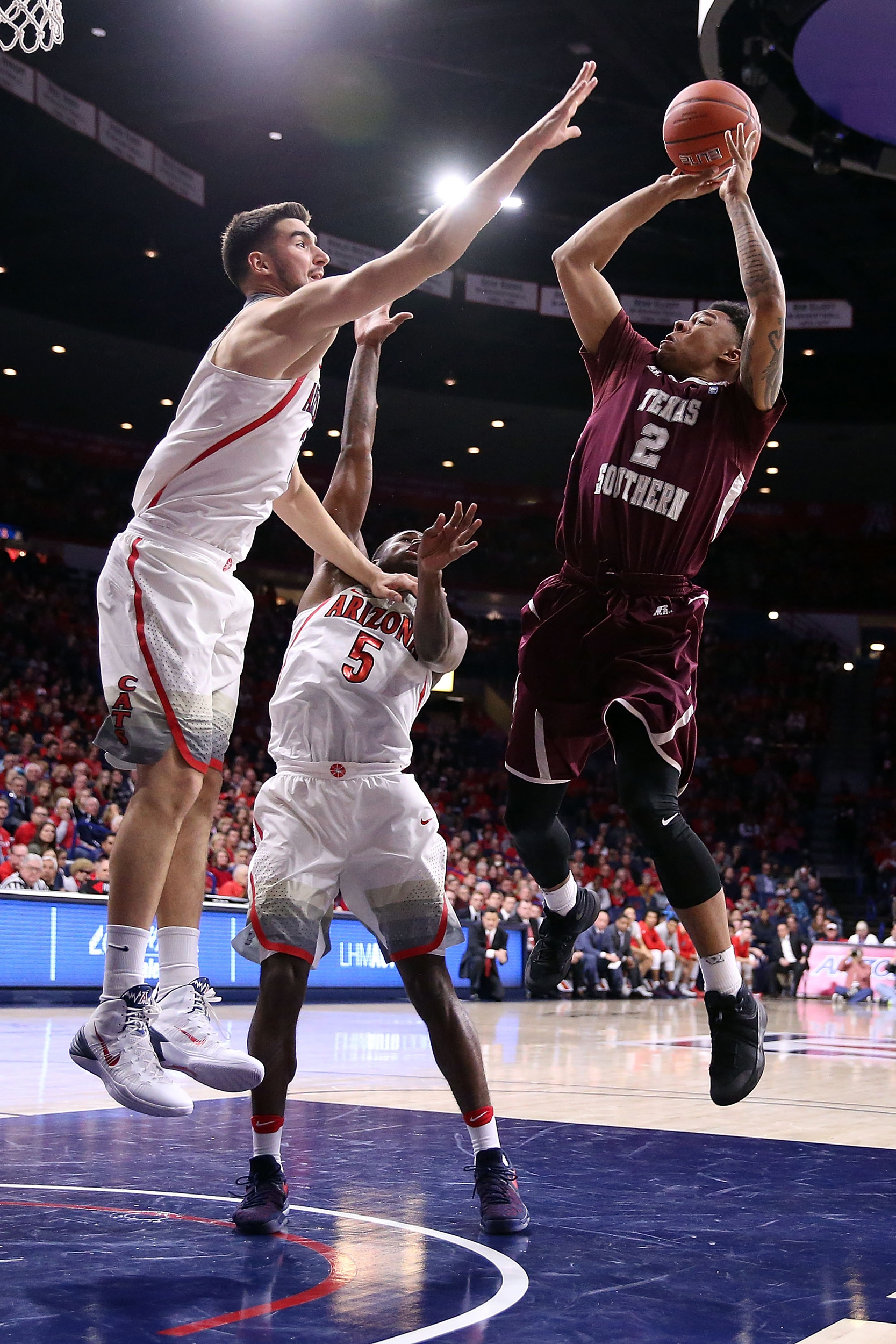Zach Lofton #2 of the Texas Southern Tigers shoots over Dusan Ristic #14 and Kadeem Allen #5 of the Arizona Wildcats during the second half of the NCAA college basketball game at McKale Center on November 30, 2016 in Tucson, Arizona. Arizona won 85-63.