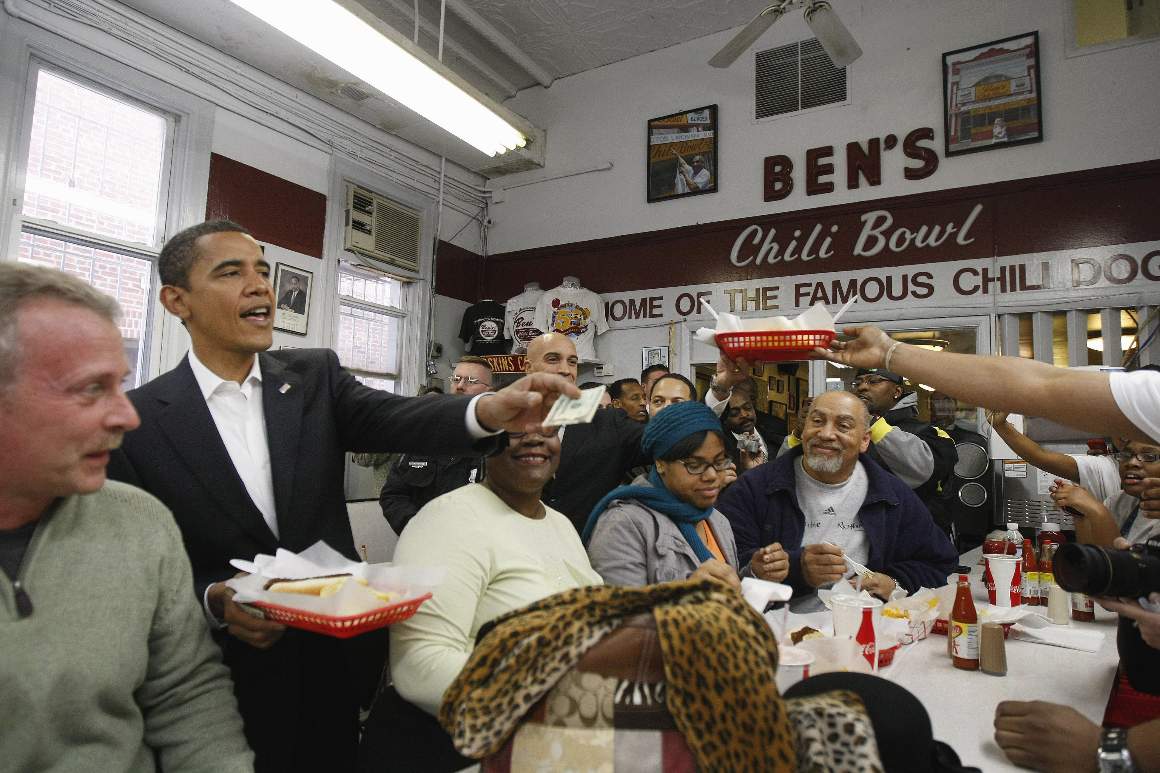 In this Jan. 10, 2009 file photo, then-President-elect Barack Obama stops to eat in Ben's Chili Bowl in Washington.