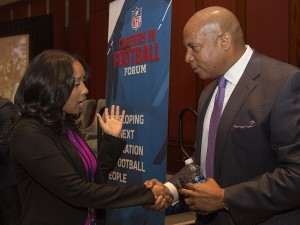 IMAGE DISTRIBUTED FOR NATIONAL FOOTBALL LEAGUE - Ahvery Thomas (left) talks with Minnesota Vikings Chief Operating Officer Kevin Warren during the NFL Football Careers Forum at the Omni Hotel in Atlanta on Friday, Dec. 16, 2016. (Phil Skinner/AP Images for National Football League)