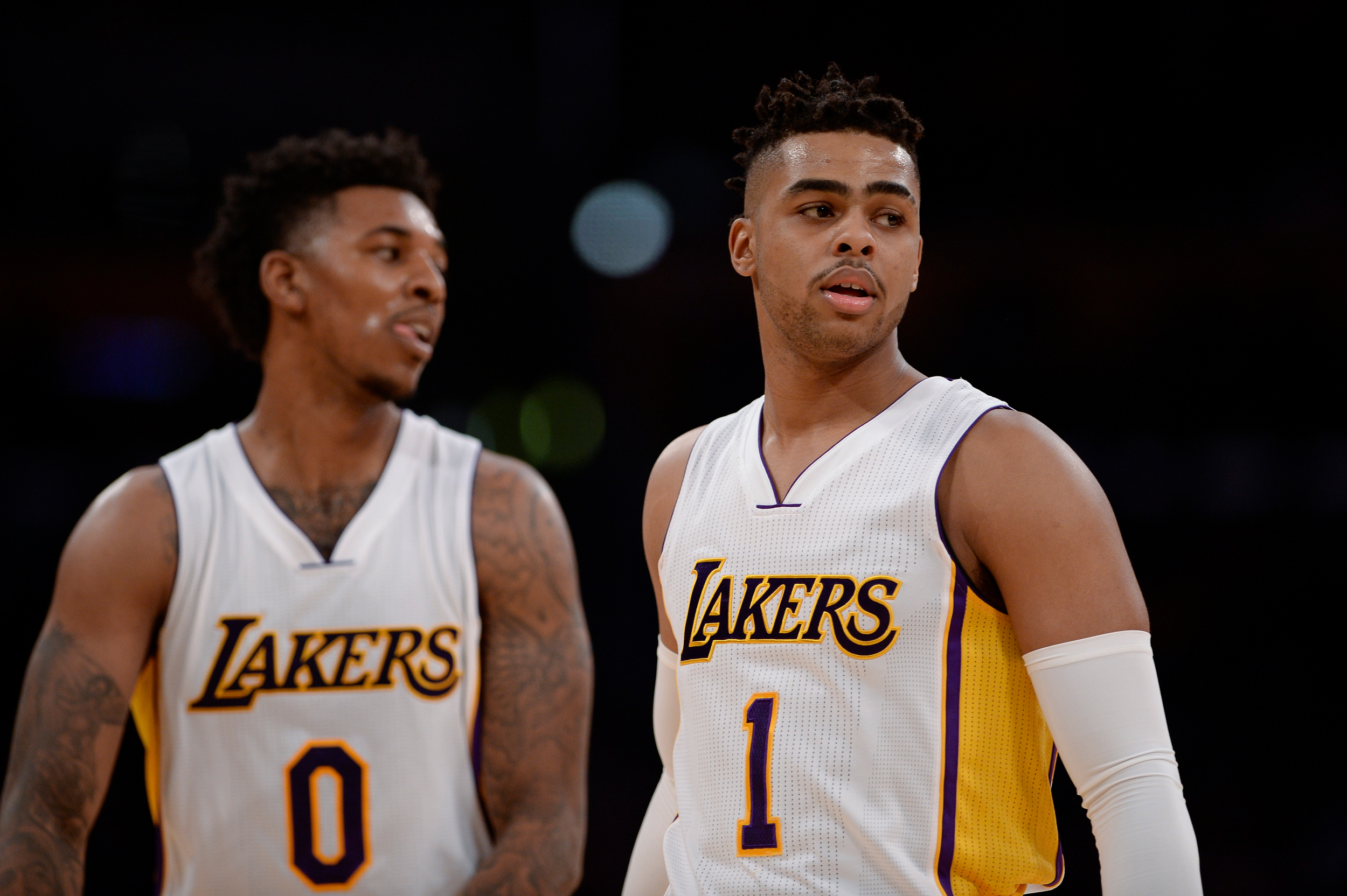 Los Angeles Lakers guard Nick Young (0) and teammate guard D'Angelo Russell (1) during the first half of an NBA basketball game against the New York Knicks, Sunday, Dec. 11, 2016, in Los Angeles.