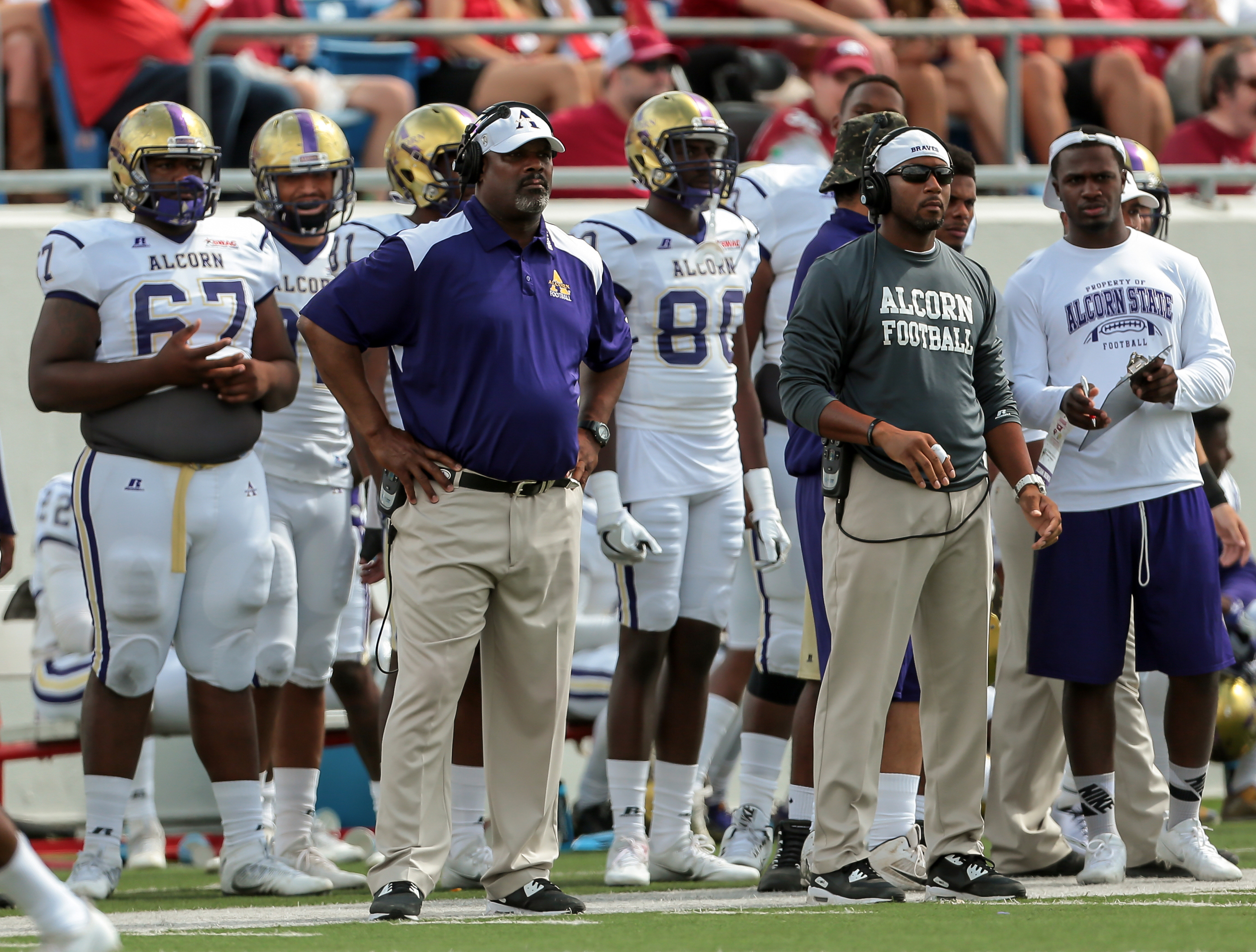 Alcorn State's head coach Fred McNair, front left, surveys the field during the second half of an NCAA football game against Arkansas on Saturday, Oct. 1, 2016, in Little Rock, Ark. Arkansas beat Alcorn State, 52-10.