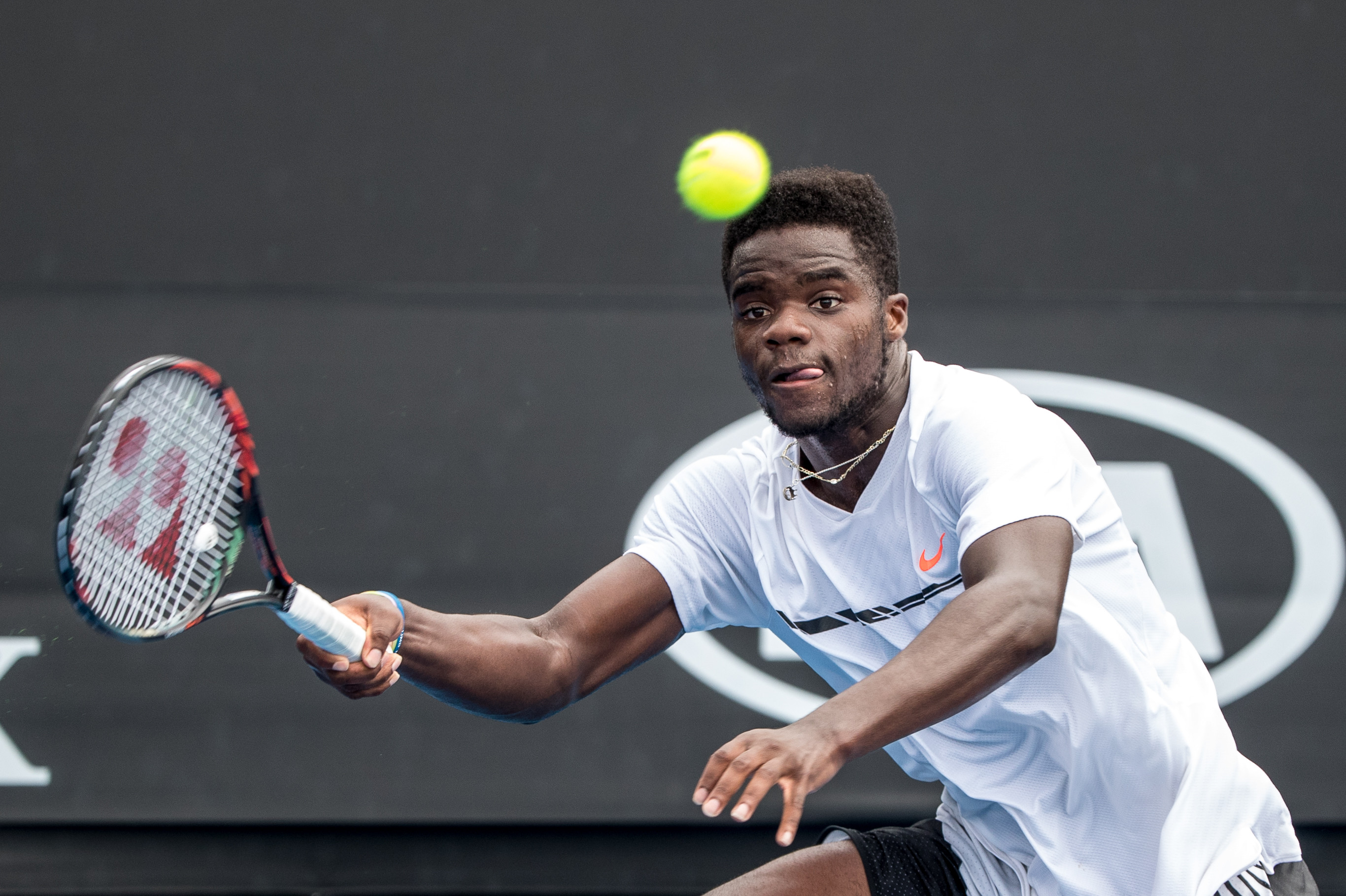 Frances Tiafoe of the United States of America returns the ball during the first round of the 2017 Australian Open on January 17, 2017, at Melbourne Park Tennis Centre in Melbourne, Australia.