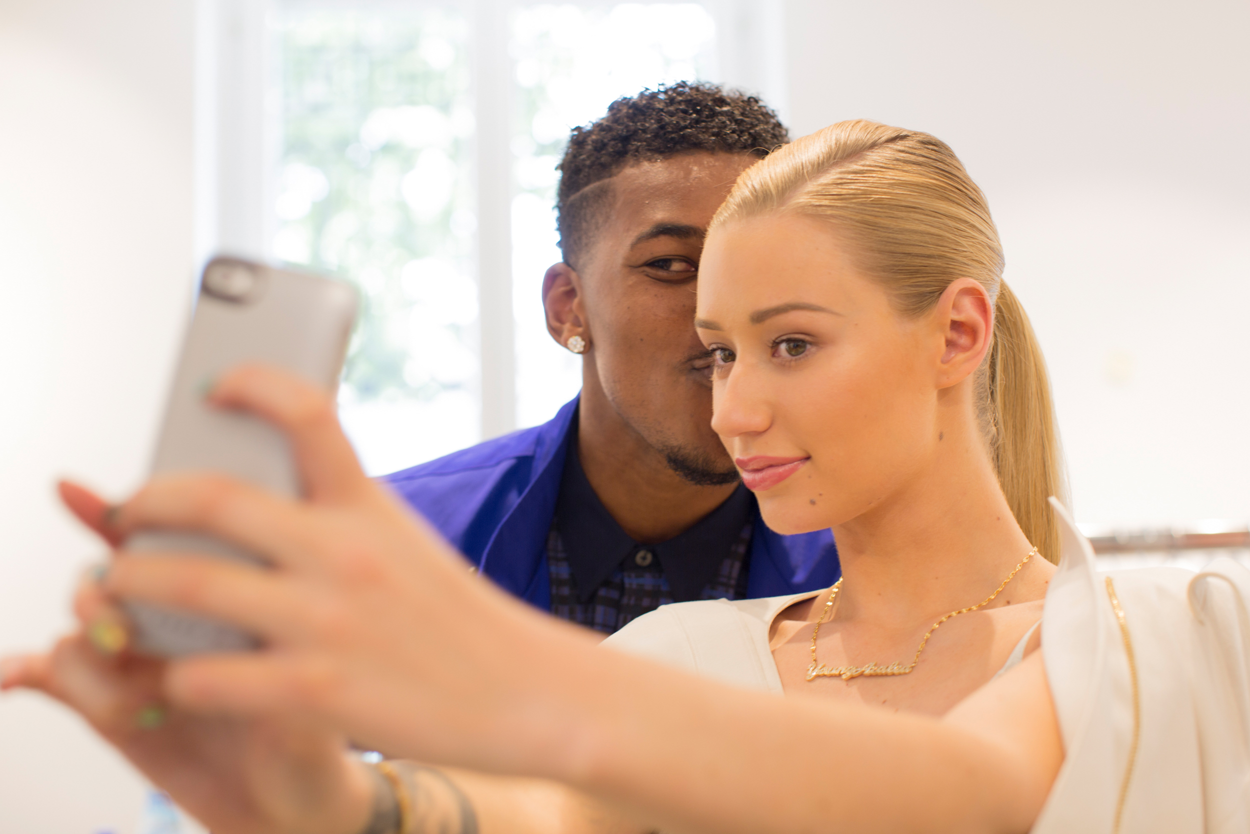 Nick Young and Iggy Azalea pose backstage during the Calvin Klein show as part of Milan Fashion Week Menswear Spring/Summer 2015 on June 22, 2014 in Milan, Italy.