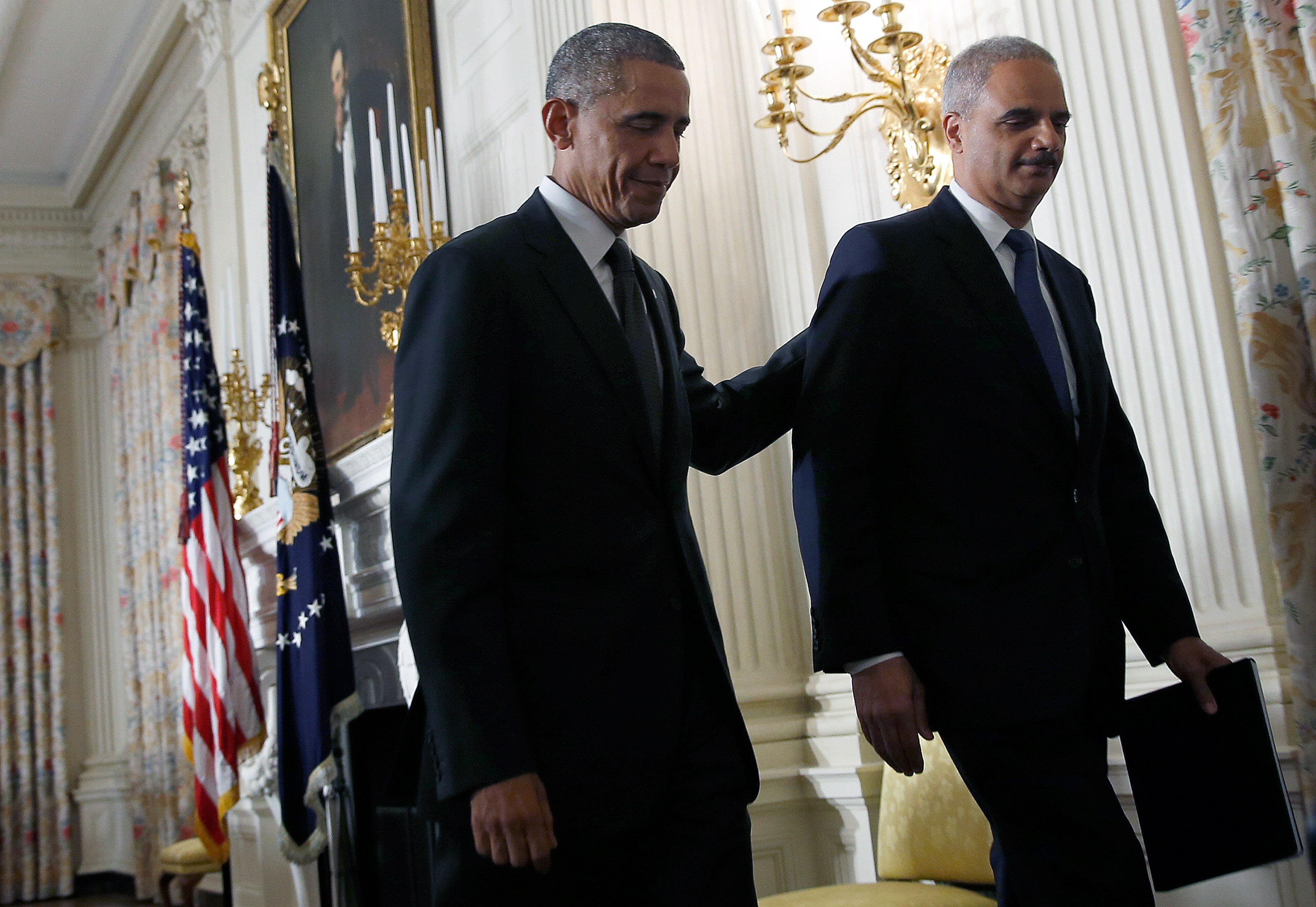 President Barack Obama and Eric Holder walking in the White House