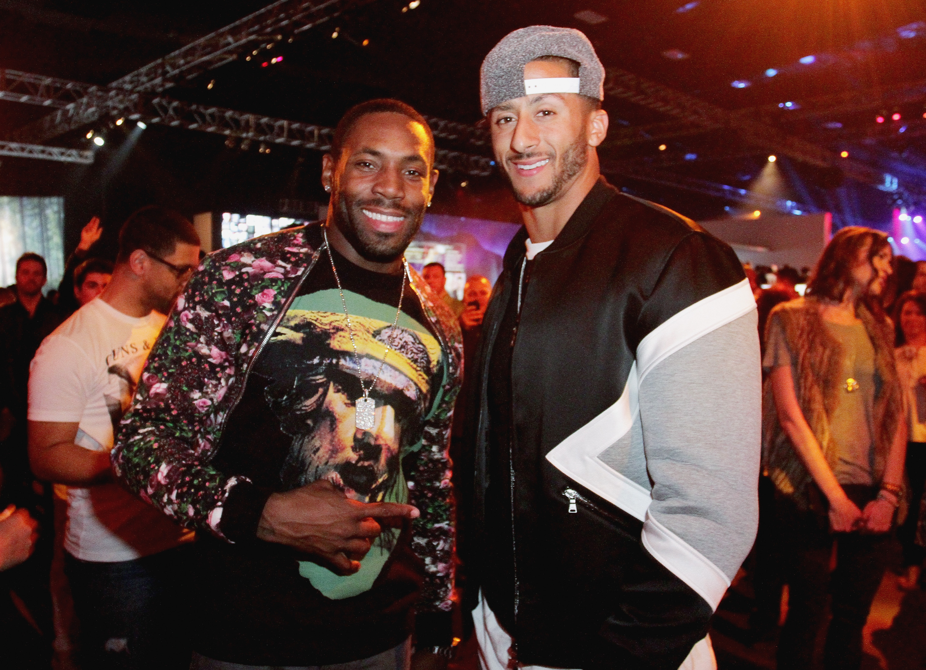 NFL players Antonio Cromartie (L) and Colin Kaepernick attend ESPN the Party at WestWorld of Scottsdale on January 30, 2015 in Scottsdale, Arizona.