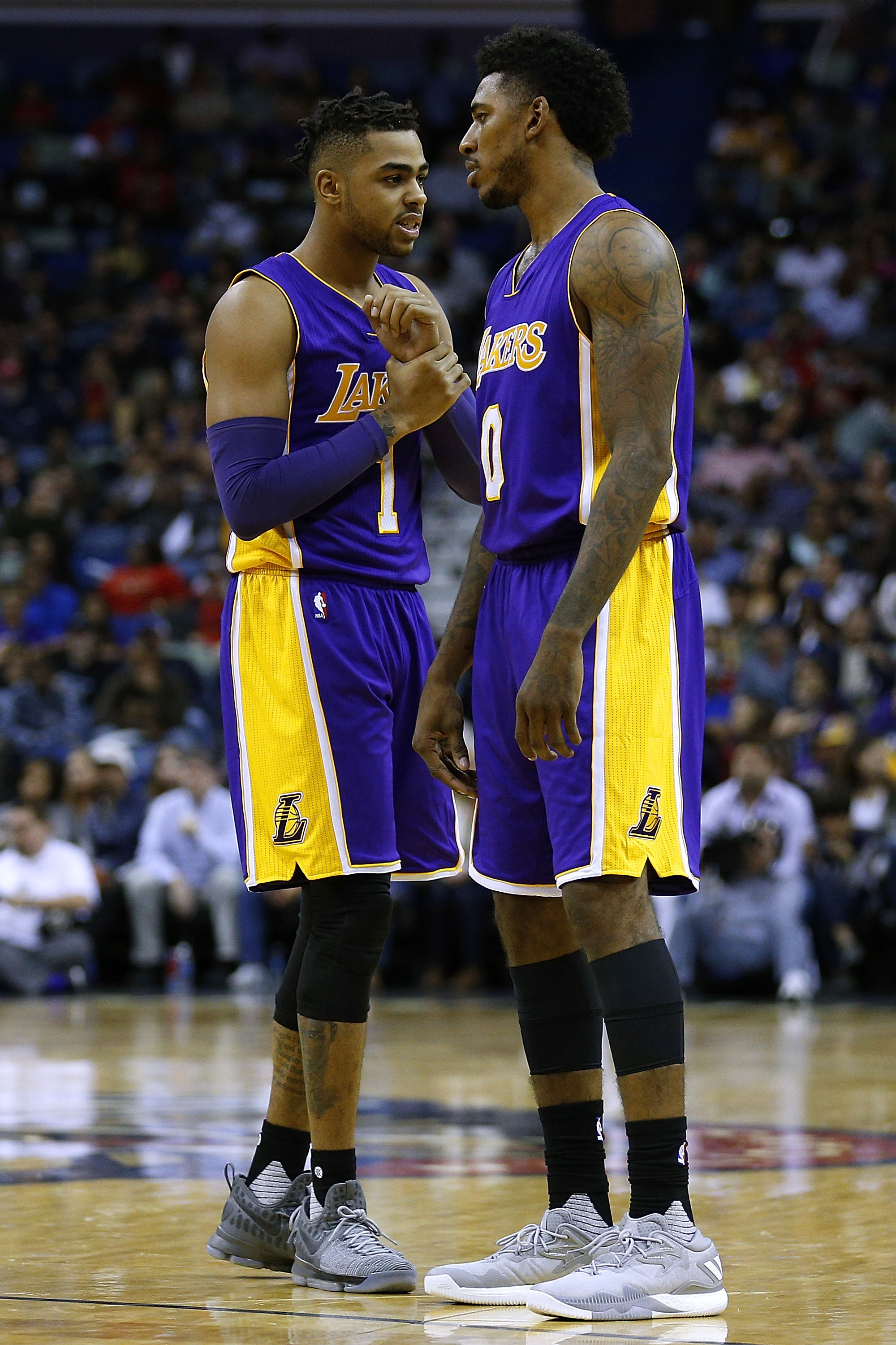 D'Angelo Russell #1 of the Los Angeles Lakers and Nick Young #0 talk during a game against the New Orleans Pelicans at the Smoothie King Center on November 12, 2016 in New Orleans, Louisiana.