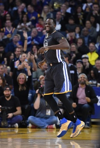 Draymond Green of the Golden State Warriors celebrates after making a three-point shot against the Phoenix Suns during an NBA basketball game at ORACLE Arena on December 3, 2016 in Oakland, California. (Photo by Thearon W. Henderson/Getty Images)