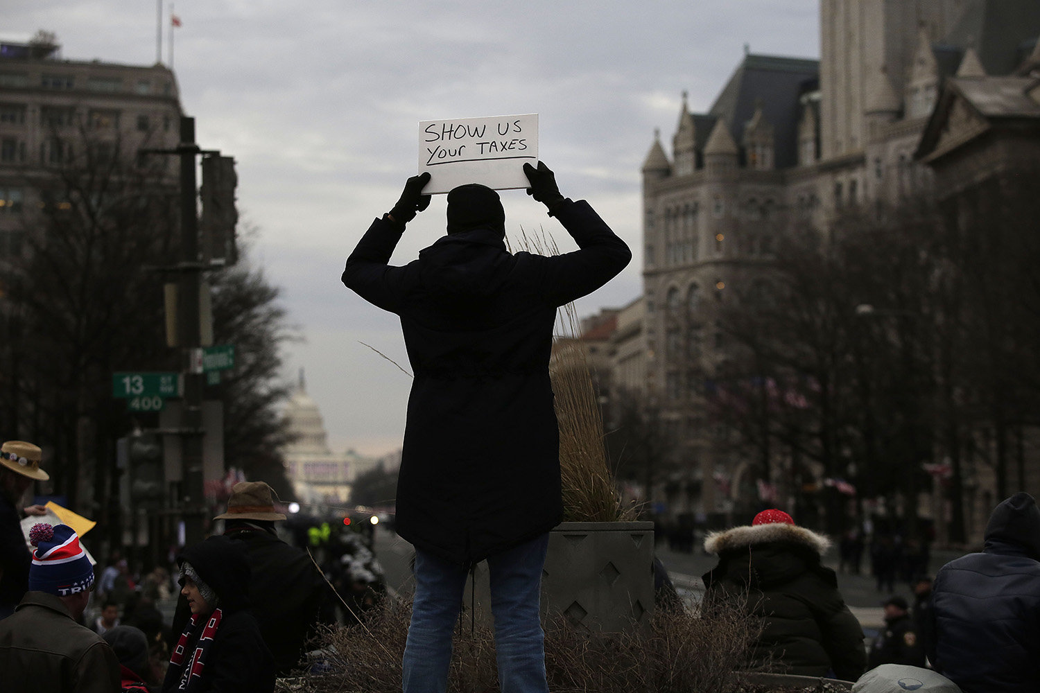 A person holds up a sign before the Presidential Inauguration of Donald Trump at Freedom Plaza on January 20, 2017 in Washington, DC. Donald Trump will be sworn in as the 45th president of the United States Friday -- capping his improbable journey to the White House and beginning a four-year term that promises to shake up Washington and the world. / AFP / Joshua LOTT (Photo credit should read JOSHUA LOTT/AFP/Getty Images)