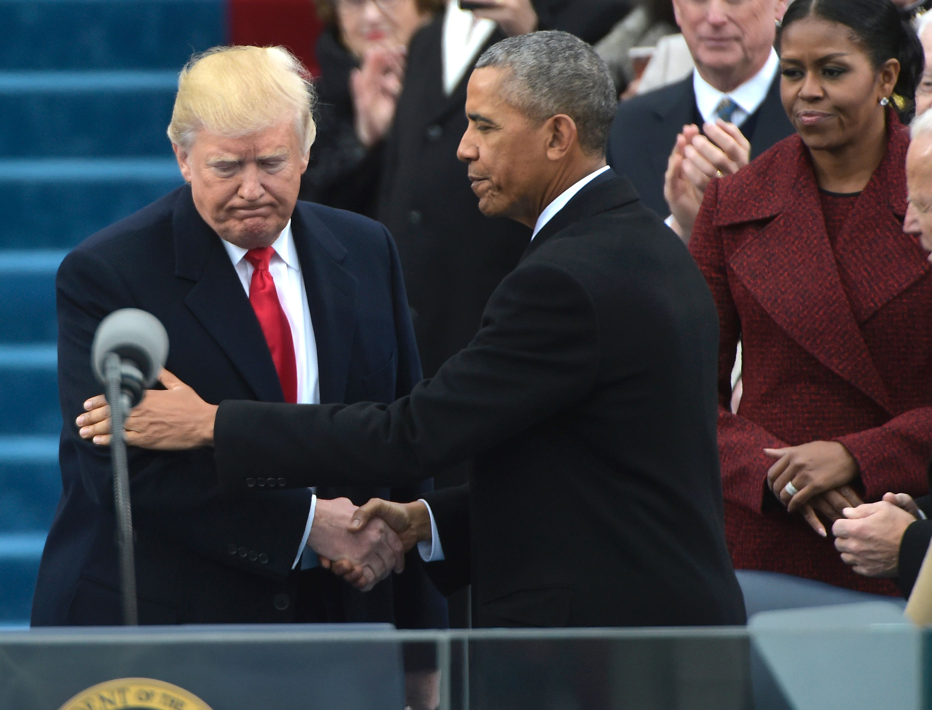US President Barack Obama (R) greets President-elect Donald Trump as he arrives on the platform at the US Capitol in Washington, DC, on January 20, 2017, before his swearing-in ceremony. / AFP / Mandel NGAN (Photo credit should read MANDEL NGAN/AFP/Getty Images)