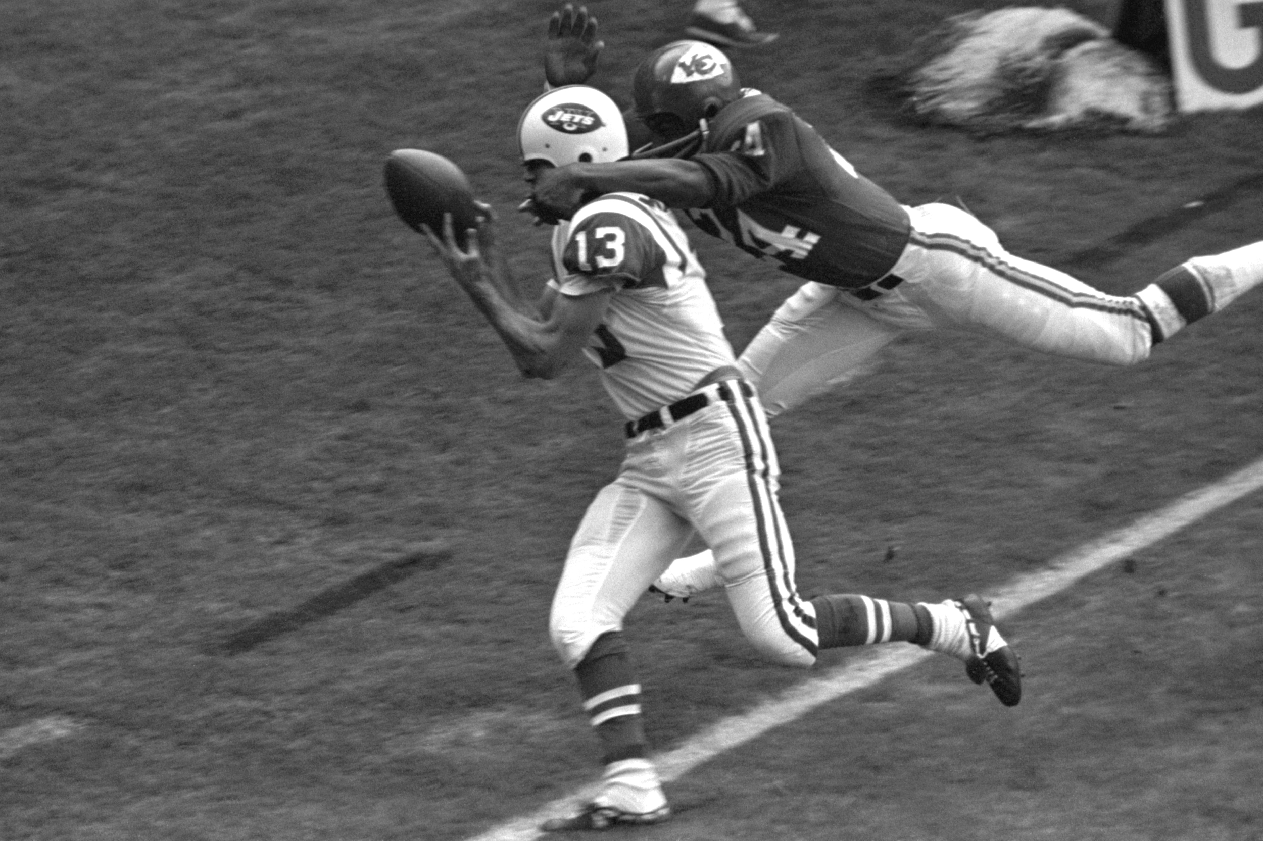 Wide receiver Don Maynard #13 of the New York Jets catches a touchdown pass in front of defensive back Fred Williamson #24 of the Kansas City Chiefs during the first quarter of a game on November 7, 1965 at Municipal Stadium in Kansas City, Missouri.
