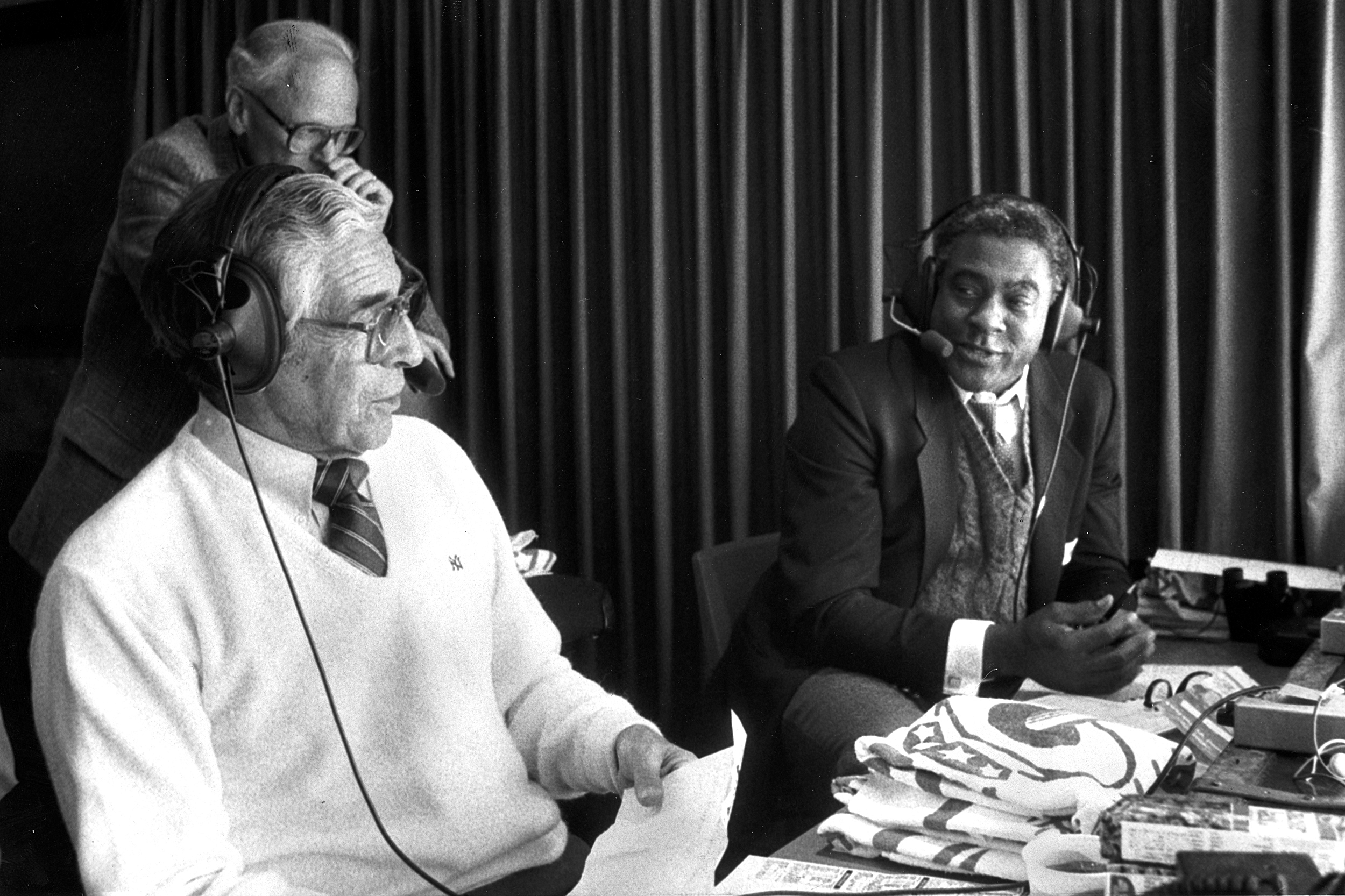 Phil Rizzuto and Bill White broadcasting Yanks-Angels game.