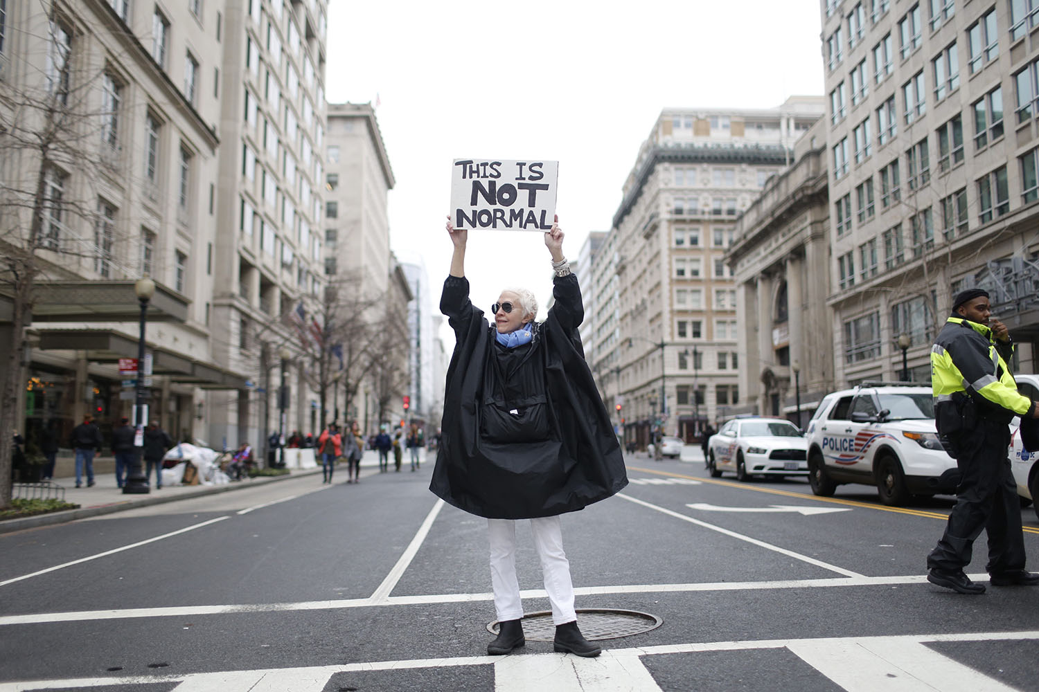 A protester stands in the middle of a usually-busy downtown street in Washington, D.C.