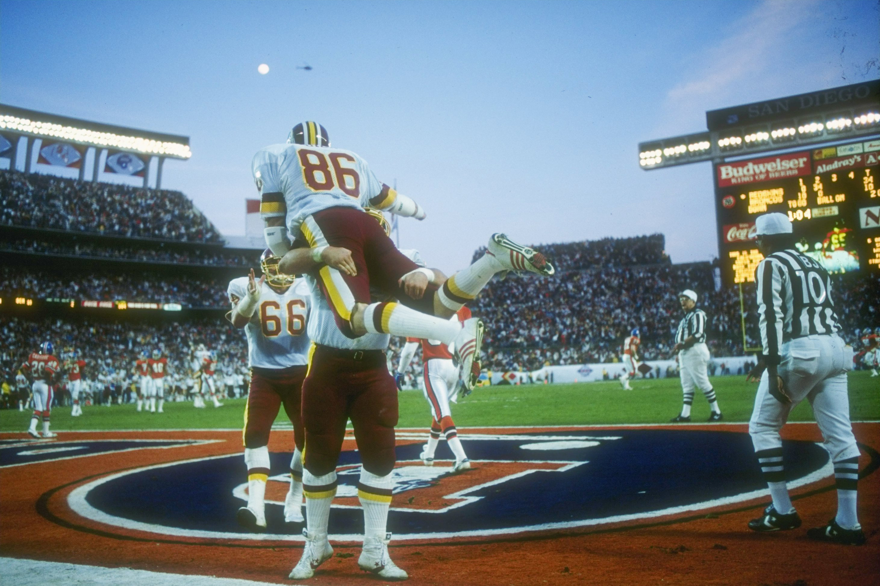 776502beb Tight end Clint Didier celebrates an eight-yard reception during second  quarter of Super Bowl XXII against the Denver Broncos at Jack Murphy  Stadium in San ...