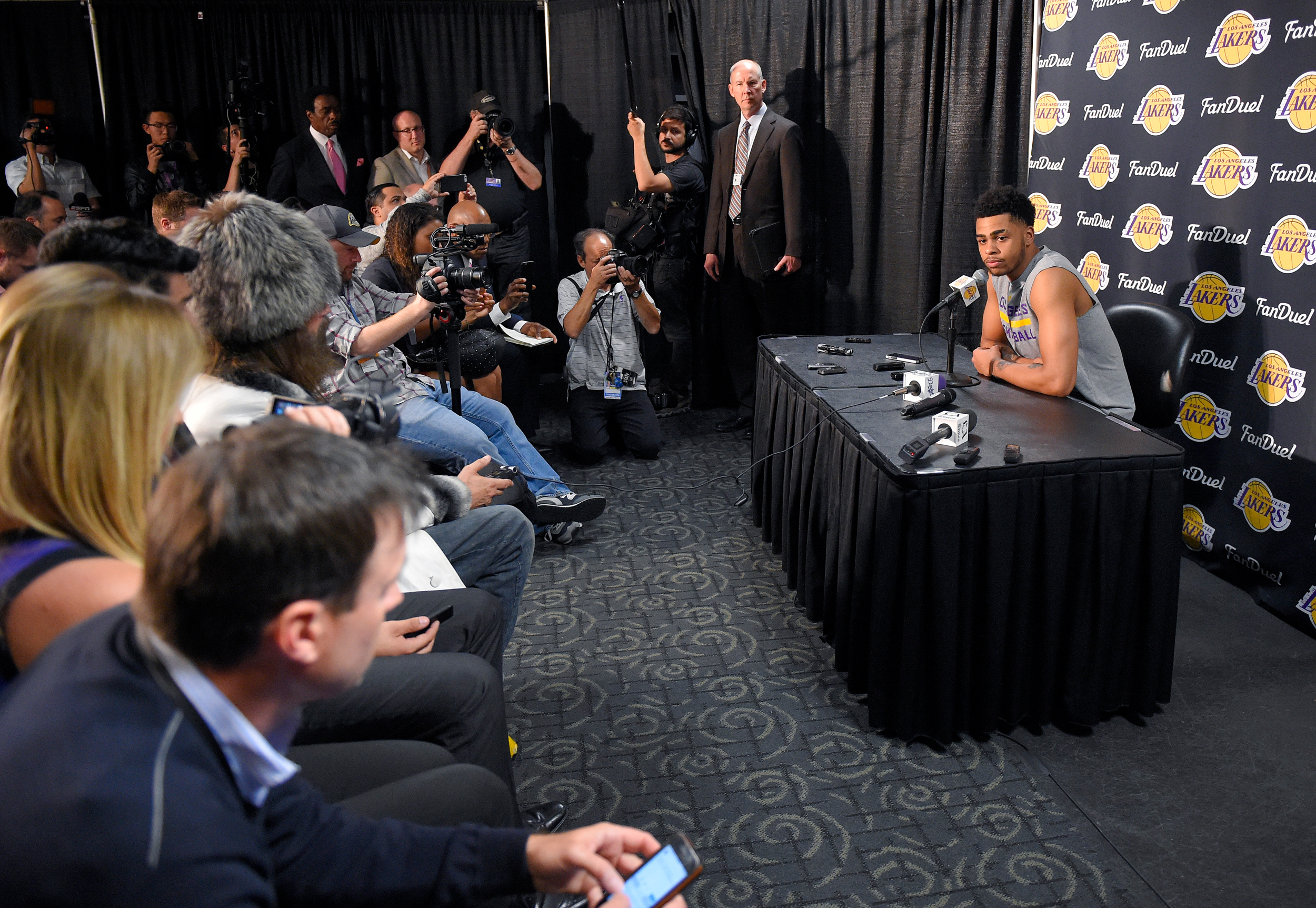 Los Angeles Lakers guard D'Angelo Russell speaks to the media prior to the team's NBA basketball game against the Miami Heat, Wednesday, March 30, 2016, in Los Angeles. Russell apparently recorded a video in which he asked teammate Nick Young about being with women other than his fiancee, rapper Iggy Azalea. The video began circulating online in the past week.
