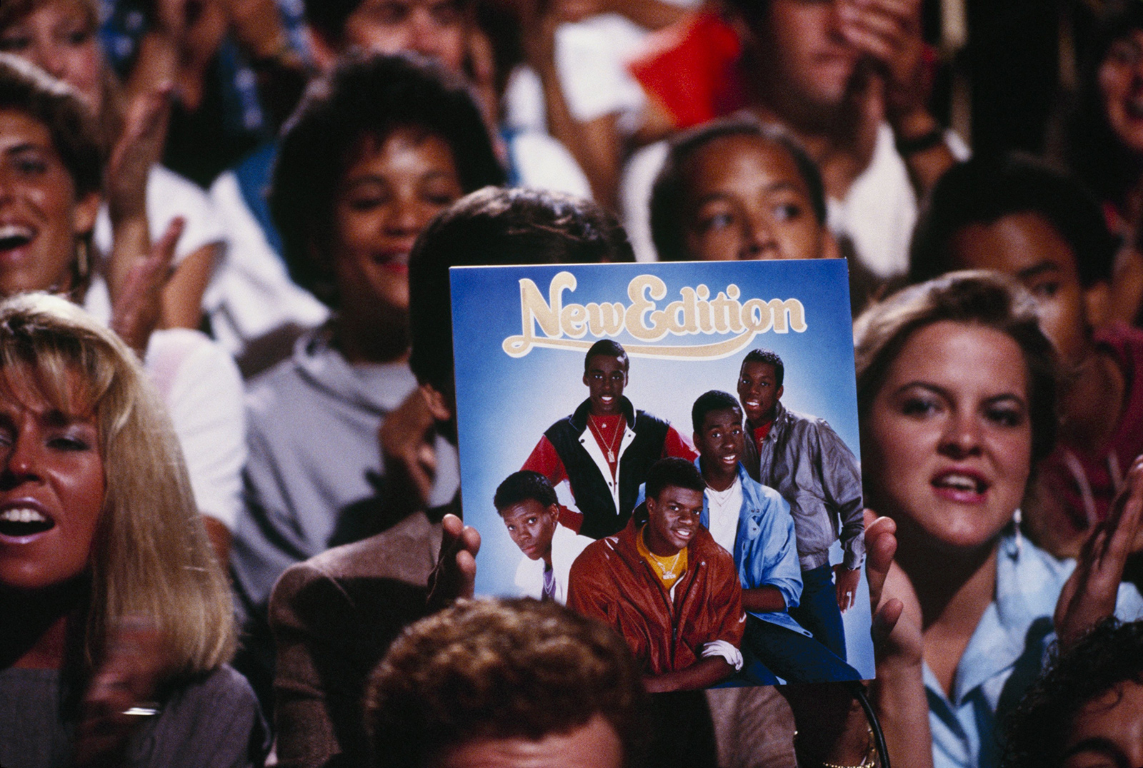 "A fan holds an album cover during the taping of ""American Bandstand"" September 11, 1984."