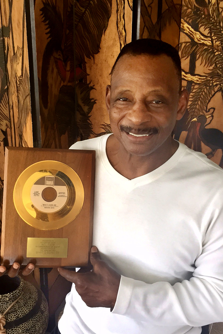 "Mel Farr with a plaque for contributing to Marvin Gaye's record ""What's Going On?"""