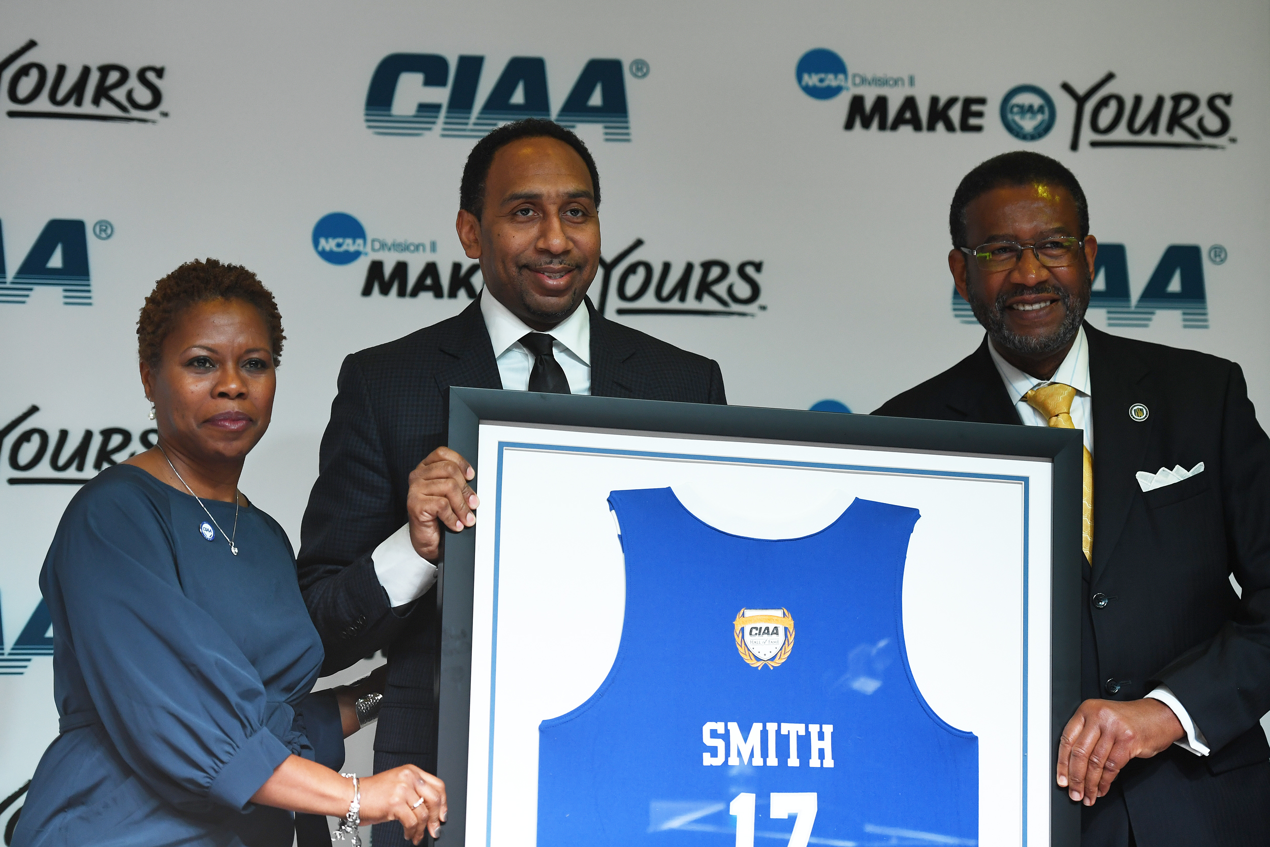 Stephen Smith holds up a framed Hall of Fame jersey during the CIAA Hall of Fame presentation on February 24, 2017 at the Charlotte Convention Center in Charlotte, North Carolina.