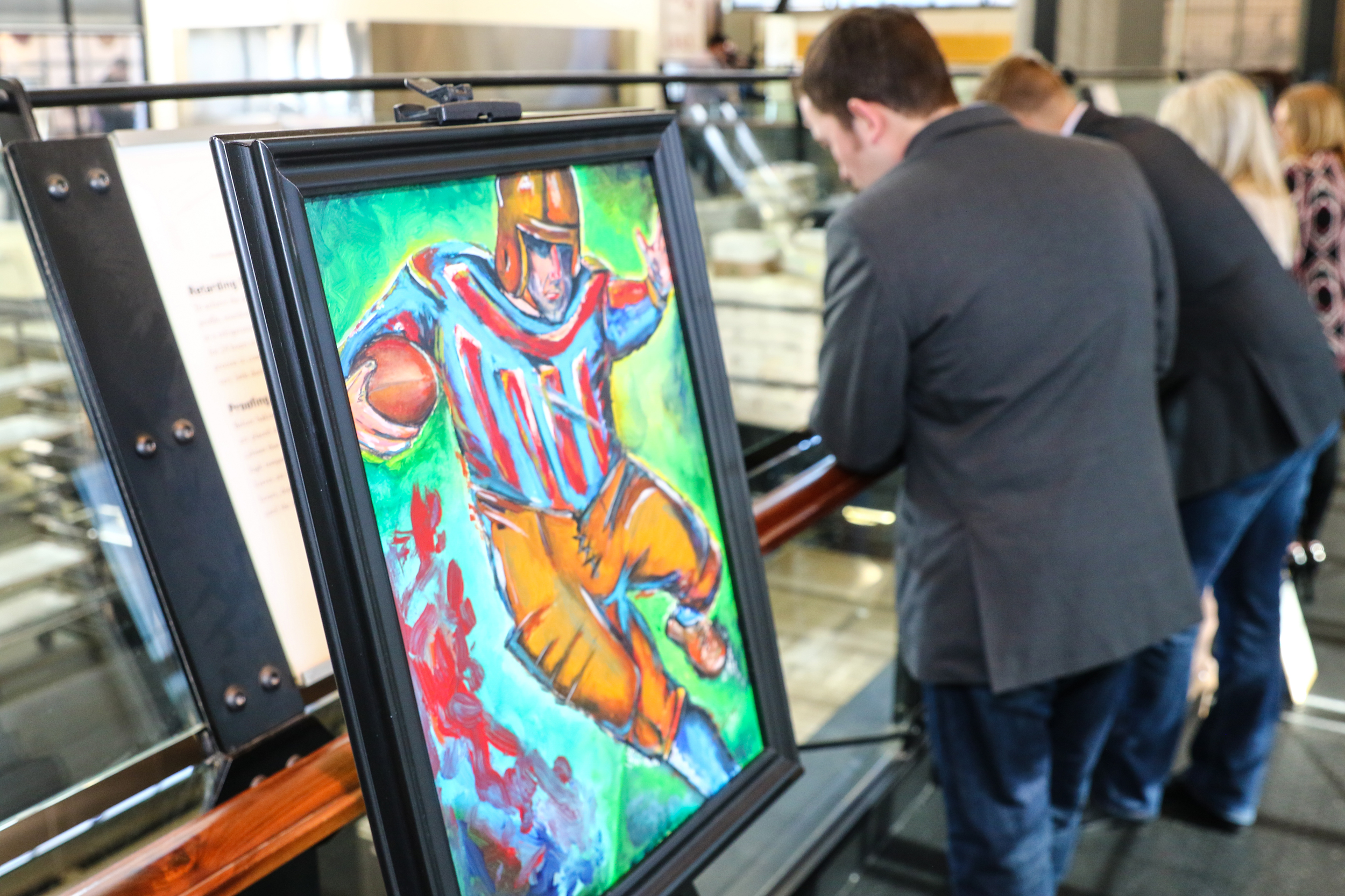 People check out artwork at the 2016 Smocks and Jocks event.