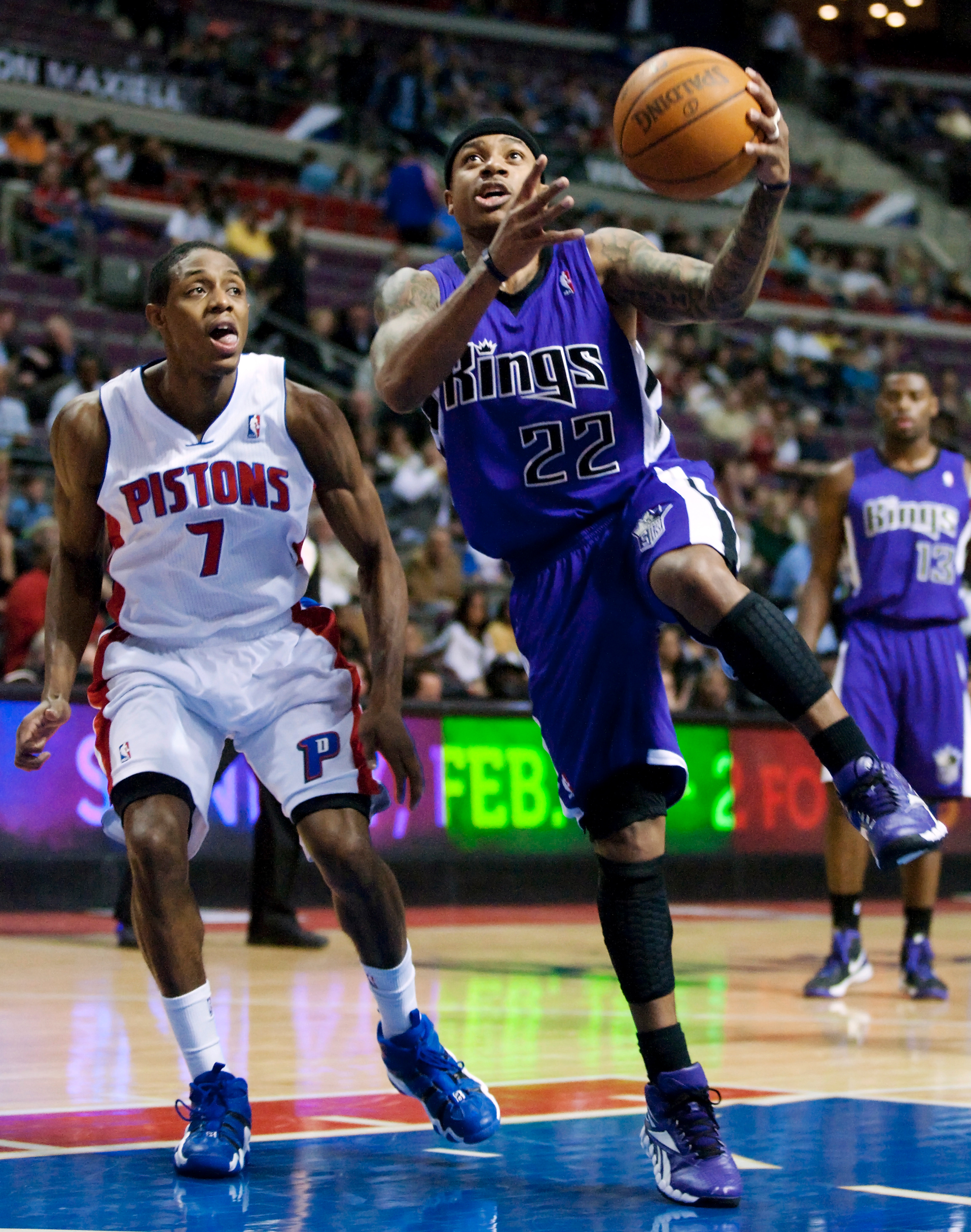 Sacramento Kings' Isaiah Thomas (22) drives to the basket past Detroit Pistons' Brandon Knight (7) in the first half of an NBA basketball game, Friday, Feb. 17, 2012, in Auburn Hills, Mich.