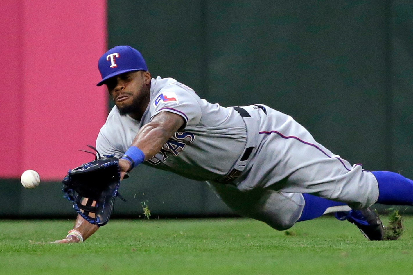 Texas Rangers center fielder Delino DeShields dives for, but misses, a double by Seattle Mariners' Seth Smith in the first inning of a baseball game Wednesday, Sept. 7, 2016, in Seattle.