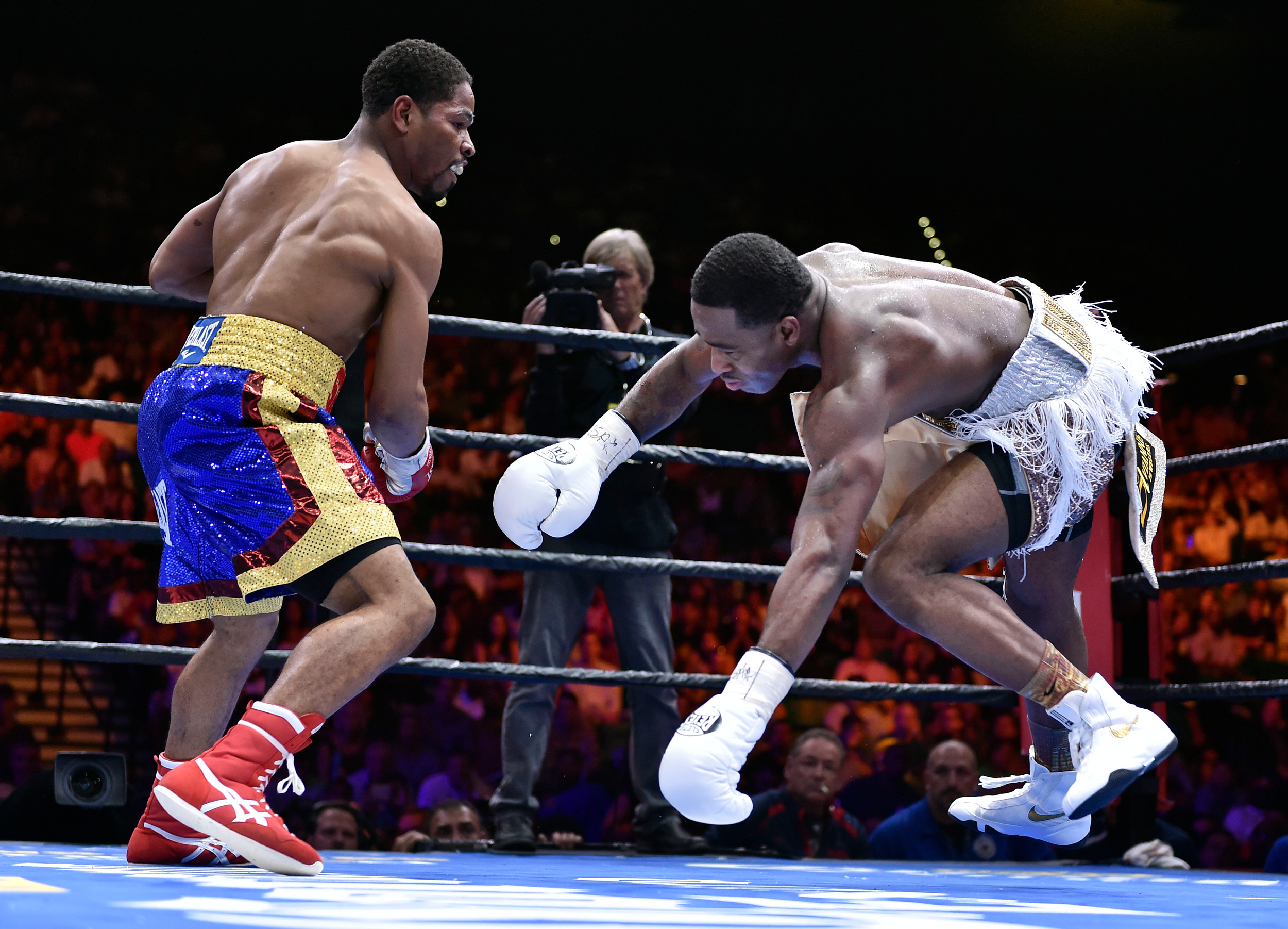 Shawn Porter, left, knocks Adrien Broner off-balance during a welterweight fight on Saturday, June 20, 2015, in Las Vegas. Porter won by unanimous decision after a 12-round bout.