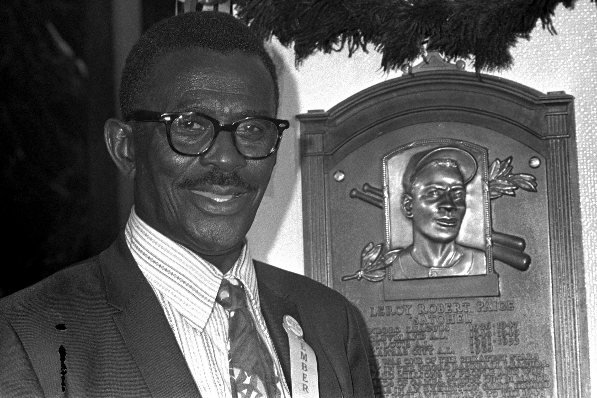"Baseball player Leroy ""Satchel"" Paige poses in front of his plaque for the Baseball Hall Fame. He was inducted August 9, 1971."